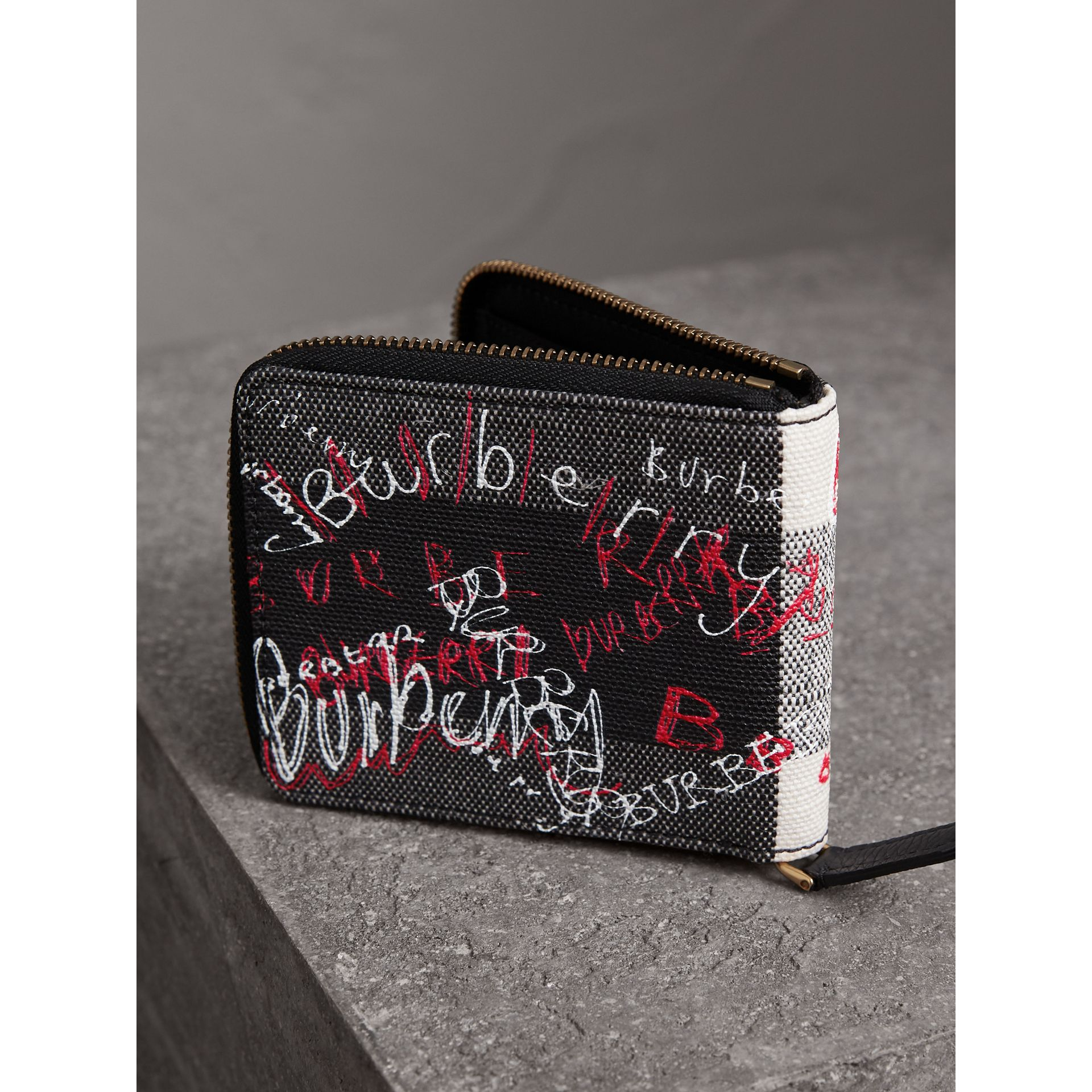Doodle Print Coated Check Canvas Ziparound Wallet in Black - Men | Burberry - gallery image 2