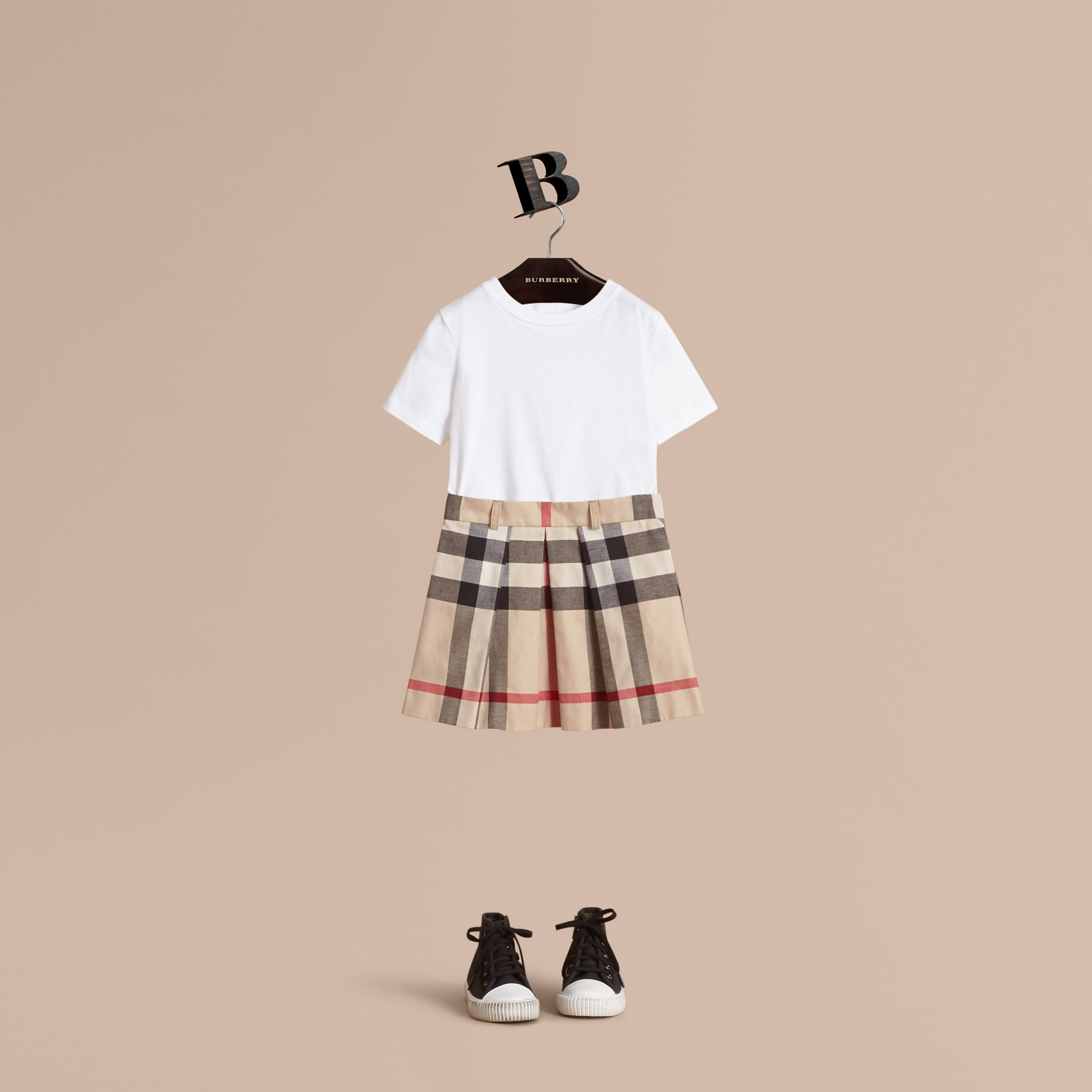 Pleated Check Cotton Skirt in Stone - Girl | Burberry - gallery image 1