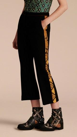 Pantalon 7/8 ajusté avec imprimé python