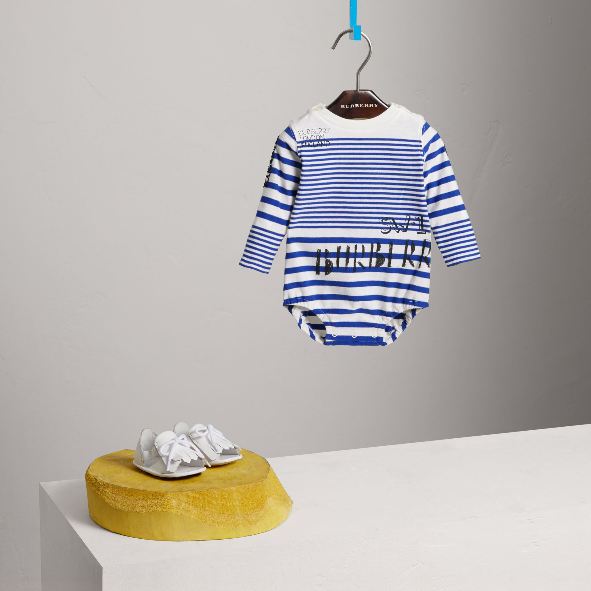 SW1 Print Striped Cotton Jersey Bodysuit in Bright Lapis/natural White - Children | Burberry Australia - gallery image 2
