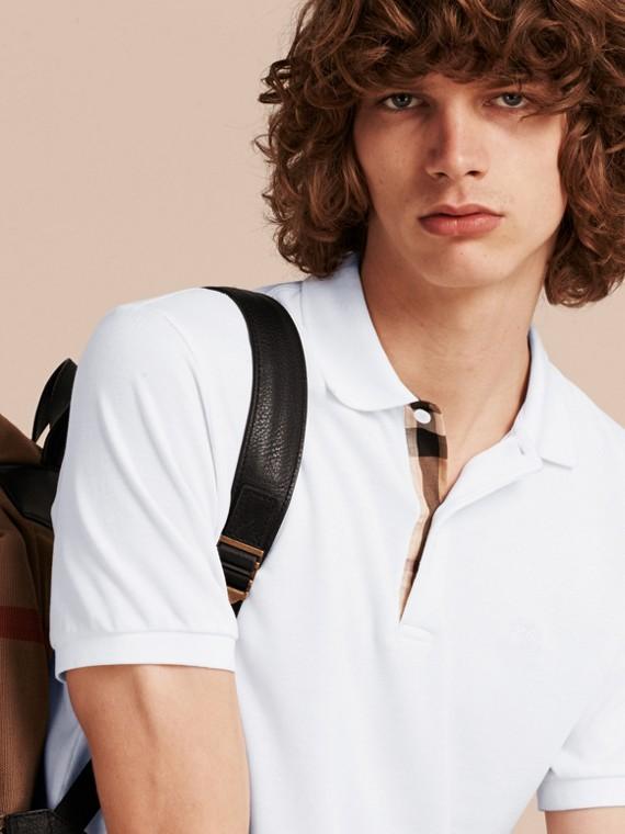 Polo in cotone piqué con paramontura check Bianco