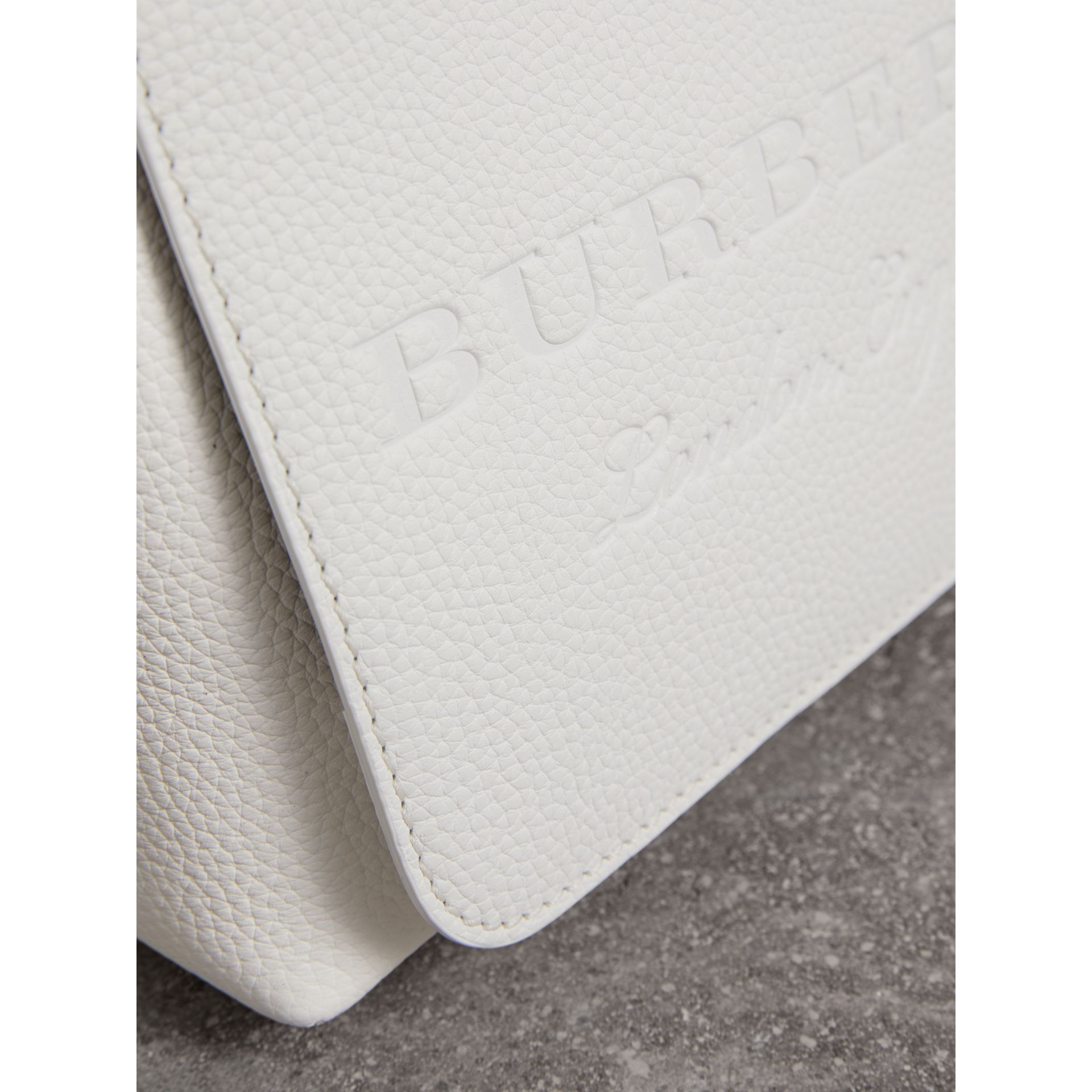 Small Embossed Leather Messenger Bag in Chalk White | Burberry - gallery image 1