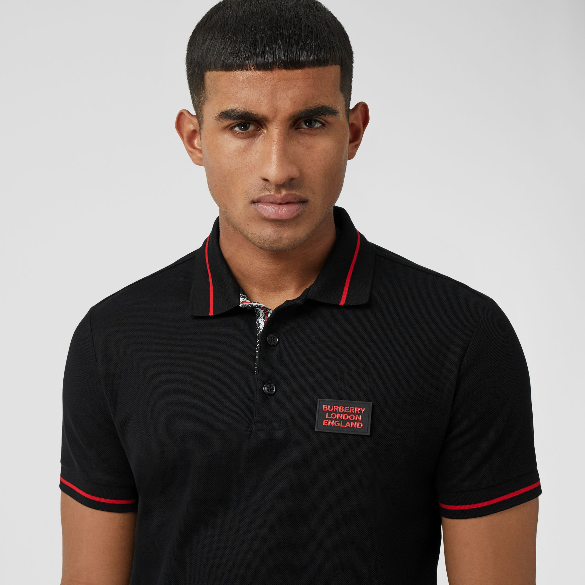 Logo Appliqué Cotton Piqué Polo Shirt in Black - Men | Burberry - gallery image 1