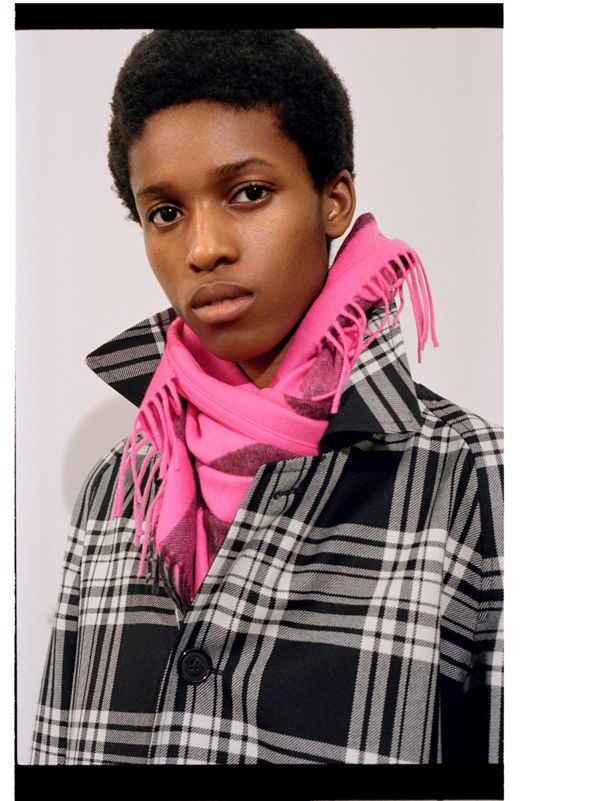 Kathia wears The Burberry Bandana looped and <br> tucked under a popped collar.