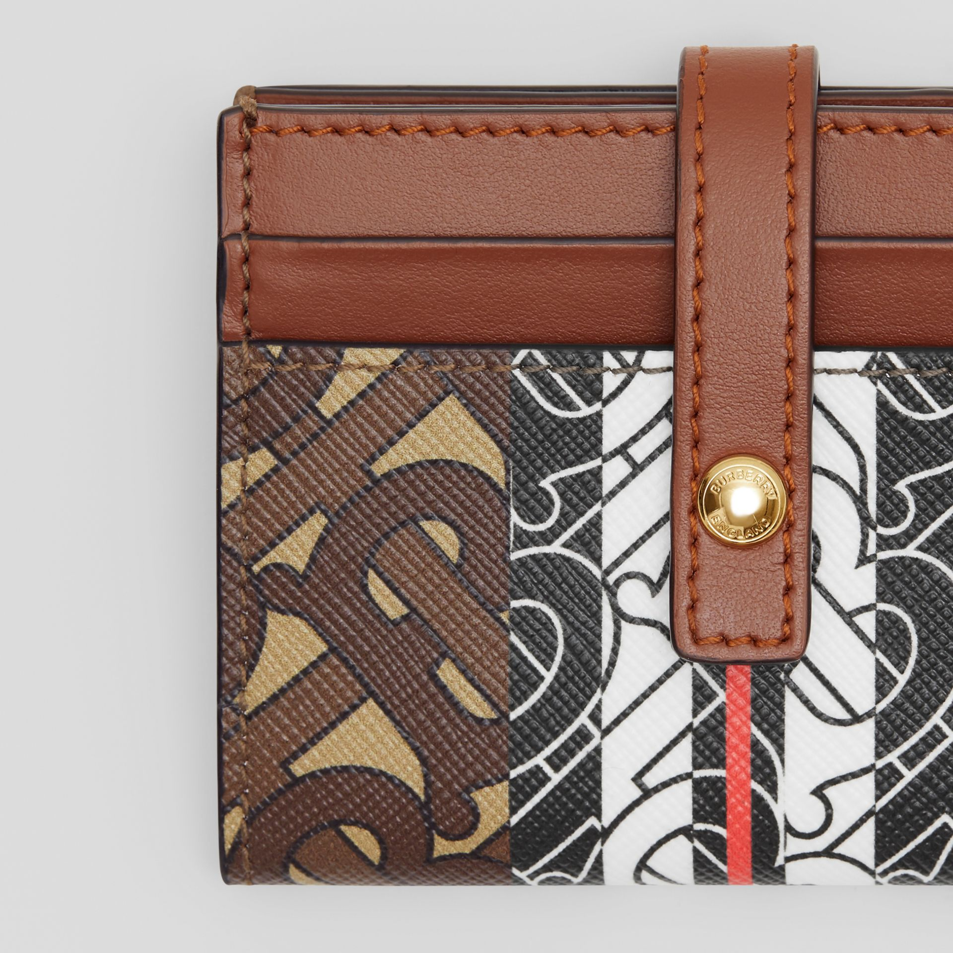 Monogram Stripe E-canvas Folding Card Case in Bridle Brown - Women | Burberry - gallery image 1