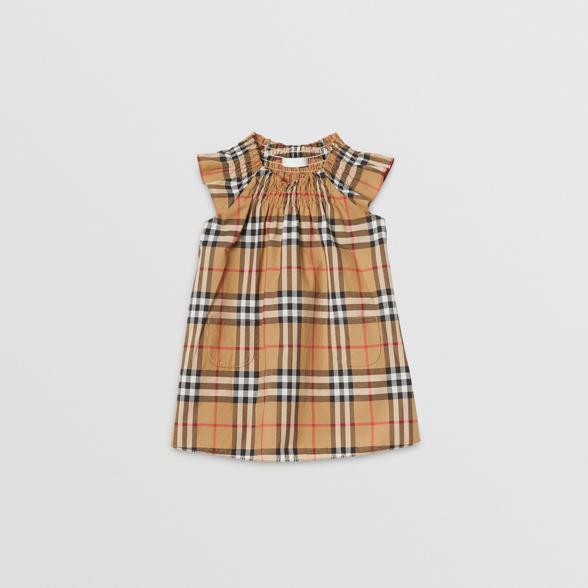 Robe en coton à motif Vintage check et smocks (Jaune Antique) - Enfant | Burberry Canada - photo de la galerie 0