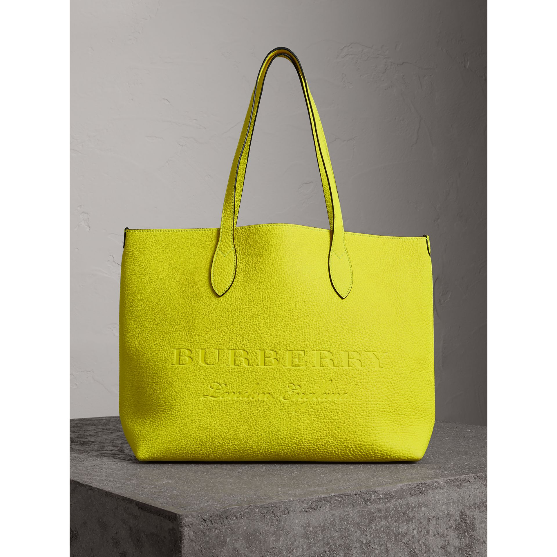 d4a02103920 Burberry - A versatile accessory in Italian calf leather, this Burberry  tote bag will instantly lift casual looks thanks to its vibrant neon hue.