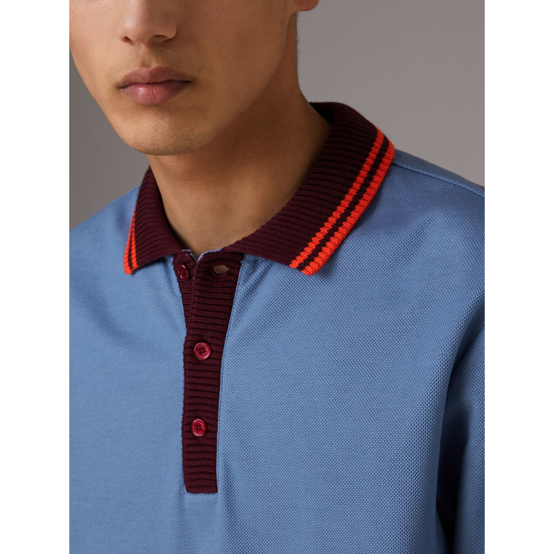 Two-tone Stripe Knitted Detail Cotton Polo Shirt in Light Blue - Men | Burberry United States - gallery image 1