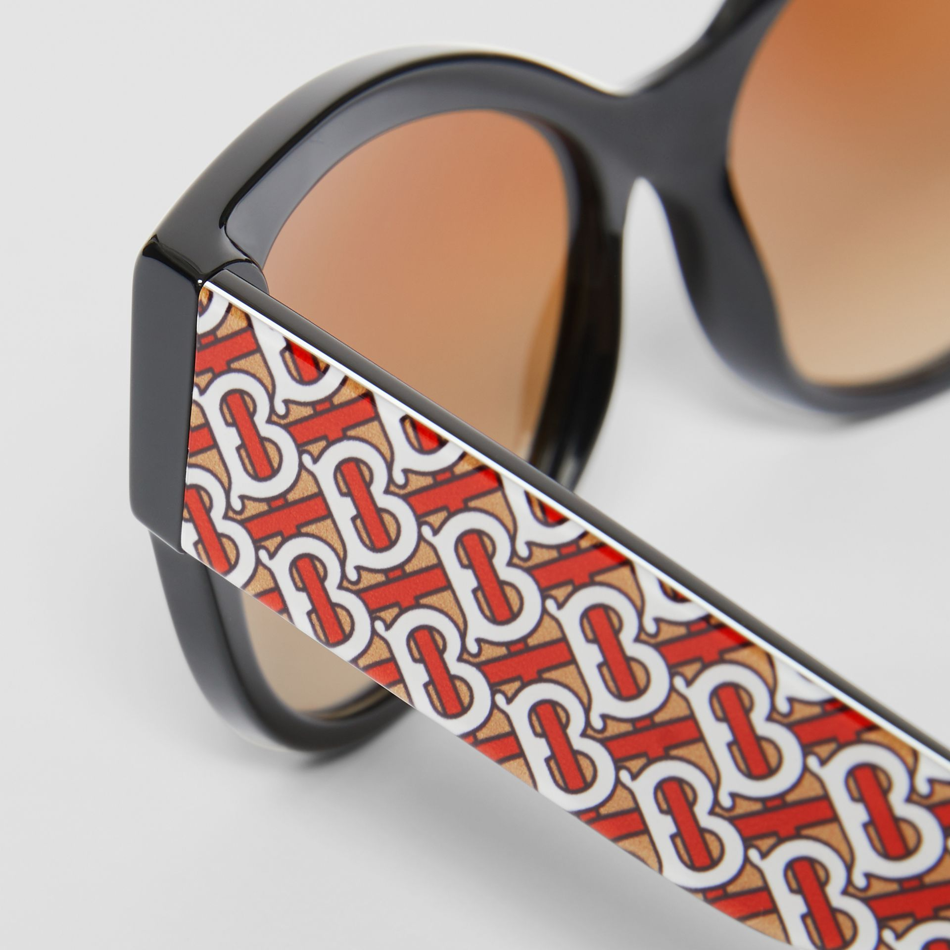 Monogram Detail Butterfly Frame Sunglasses in Black/vermillion - Women | Burberry - gallery image 1