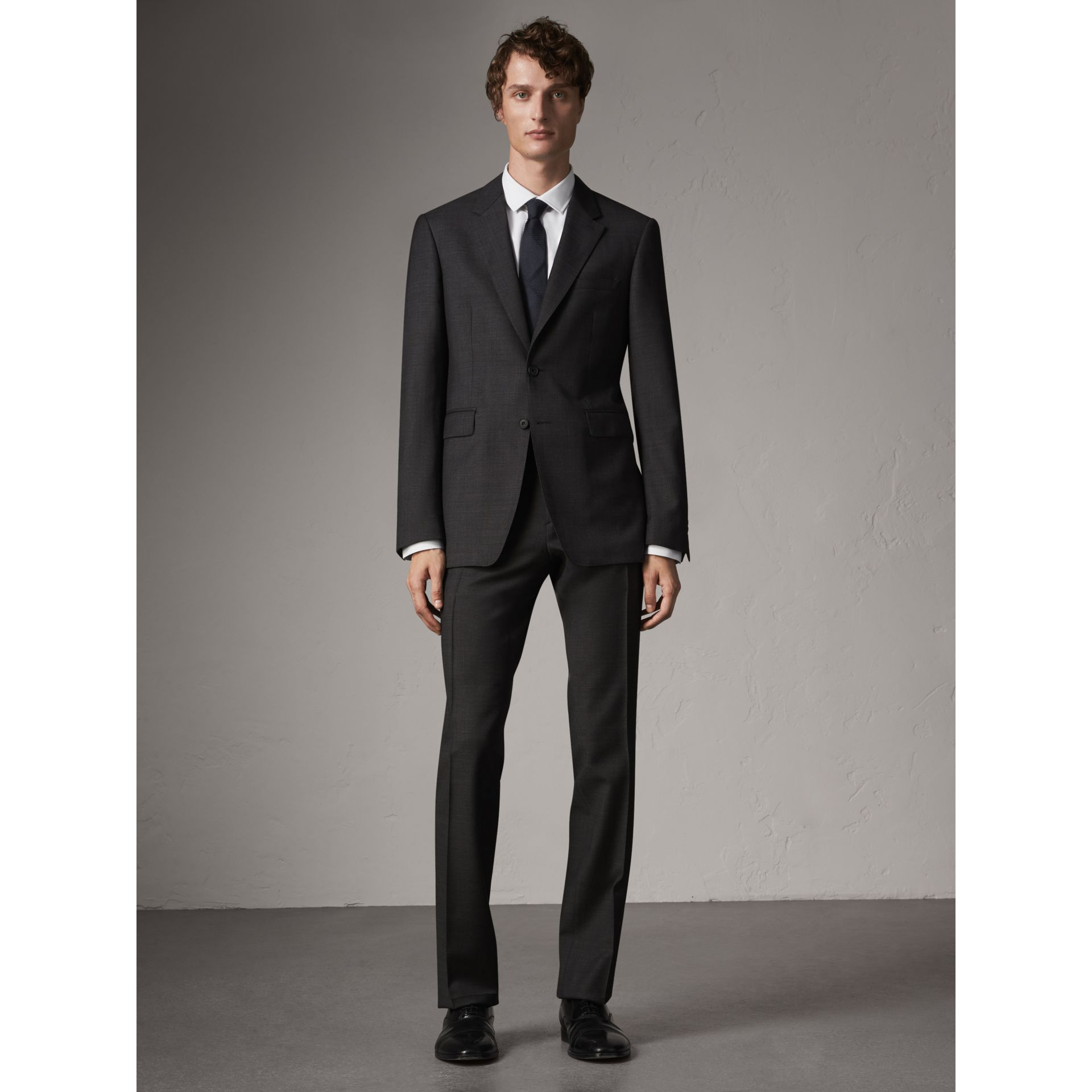 Modern Fit Travel Tailoring Virgin Wool Suit in Dark Grey Melange - Men | Burberry United Kingdom - gallery image 1