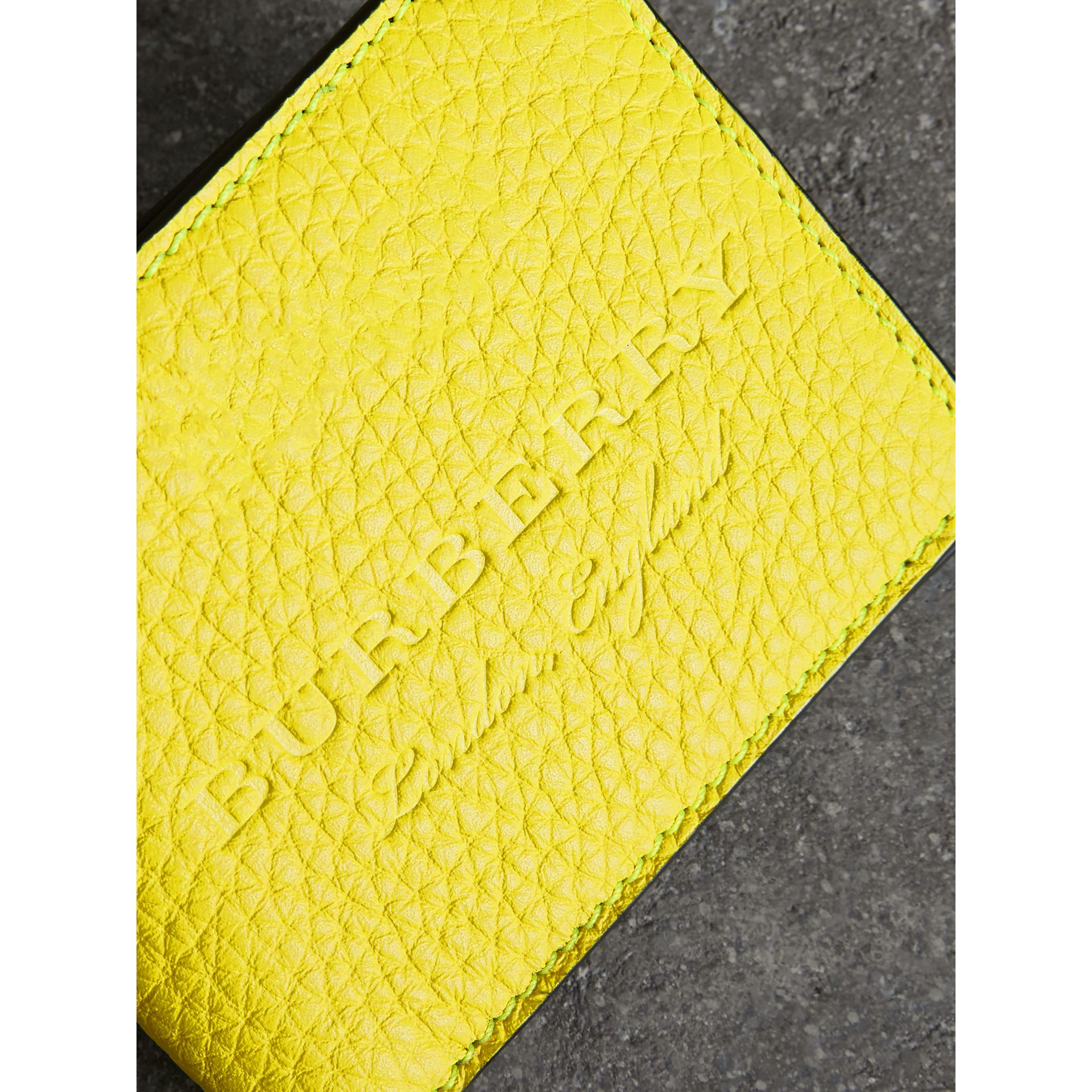 Embossed Leather Bifold Wallet in Neon Yellow - Men | Burberry United States - gallery image 1