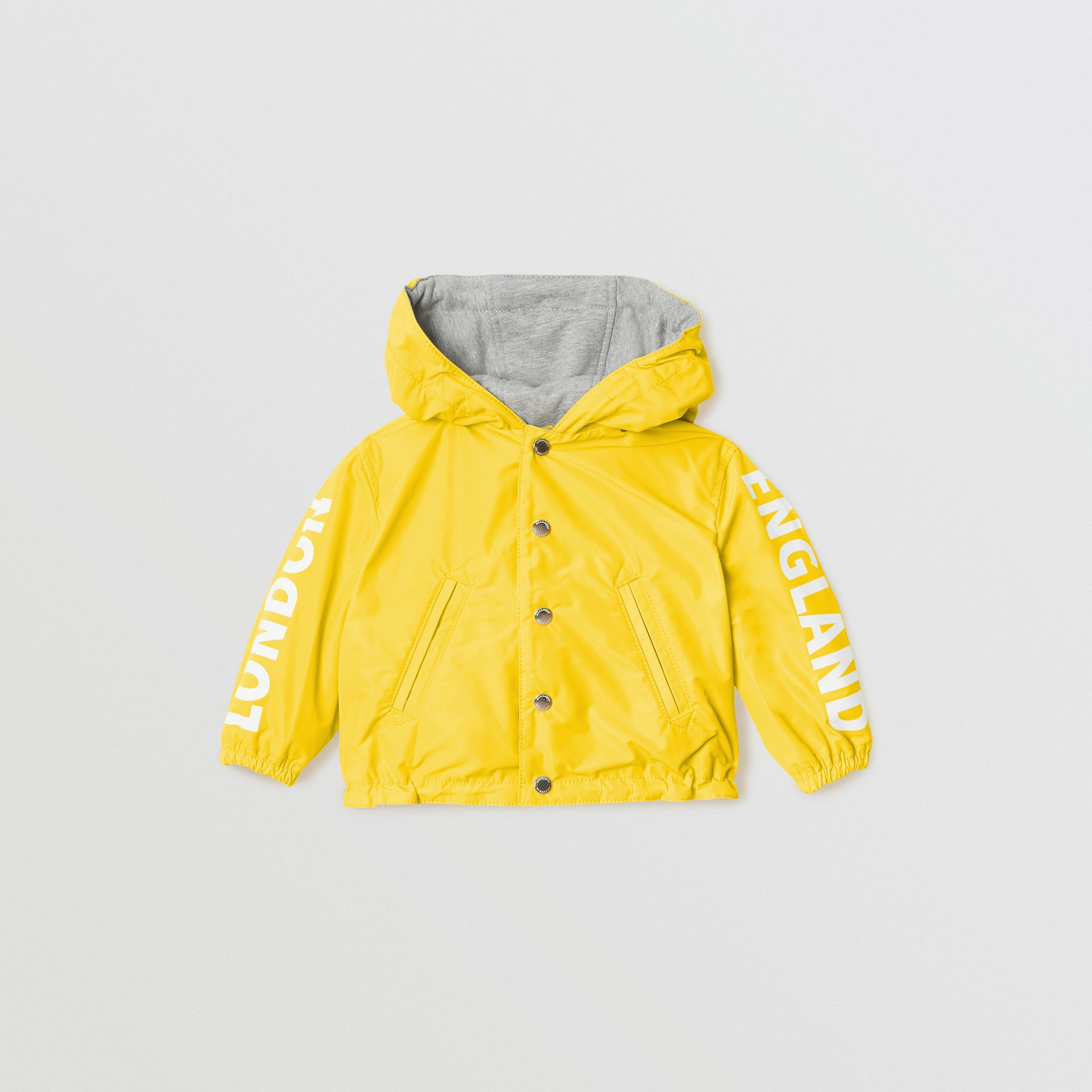 Logo Print Reversible Hooded Jacket in Bright Yellow - Children | Burberry - gallery image 0