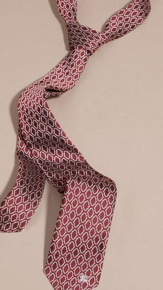 Cravate fine en jacquard de soie à motif géométrique