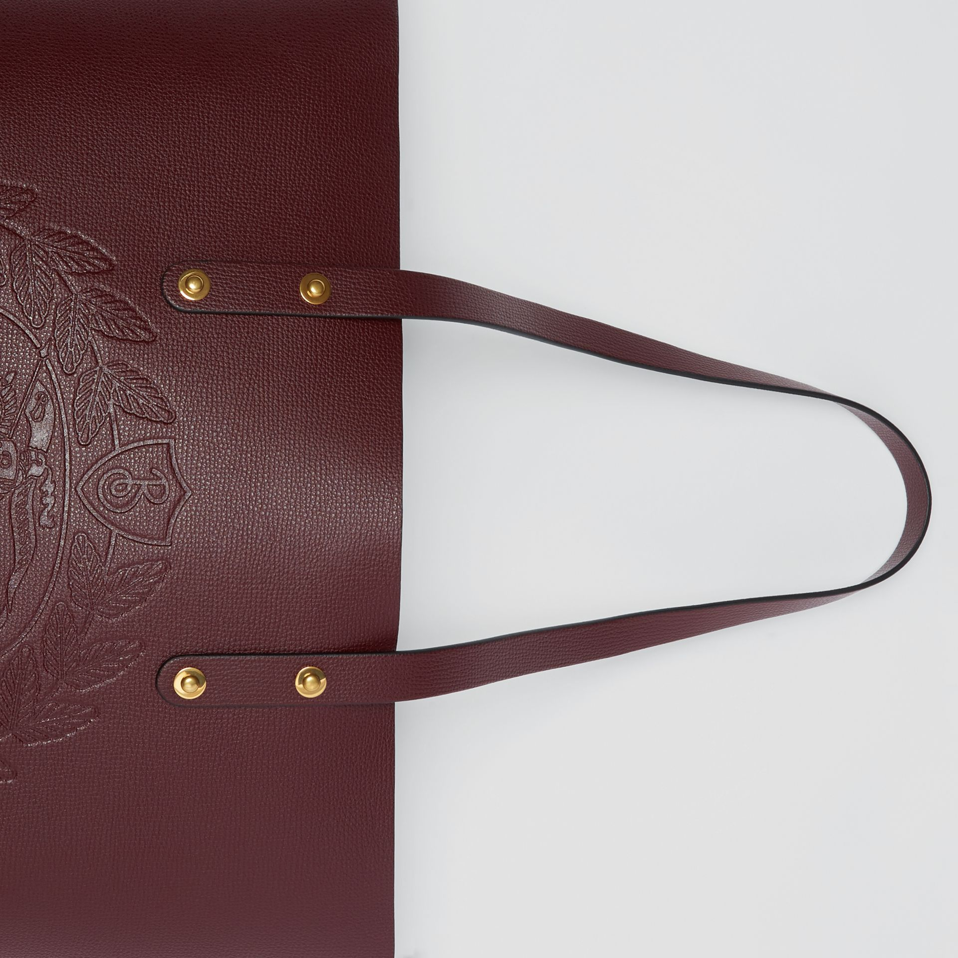 Small Embossed Crest Leather Tote in Burgundy | Burberry - gallery image 1