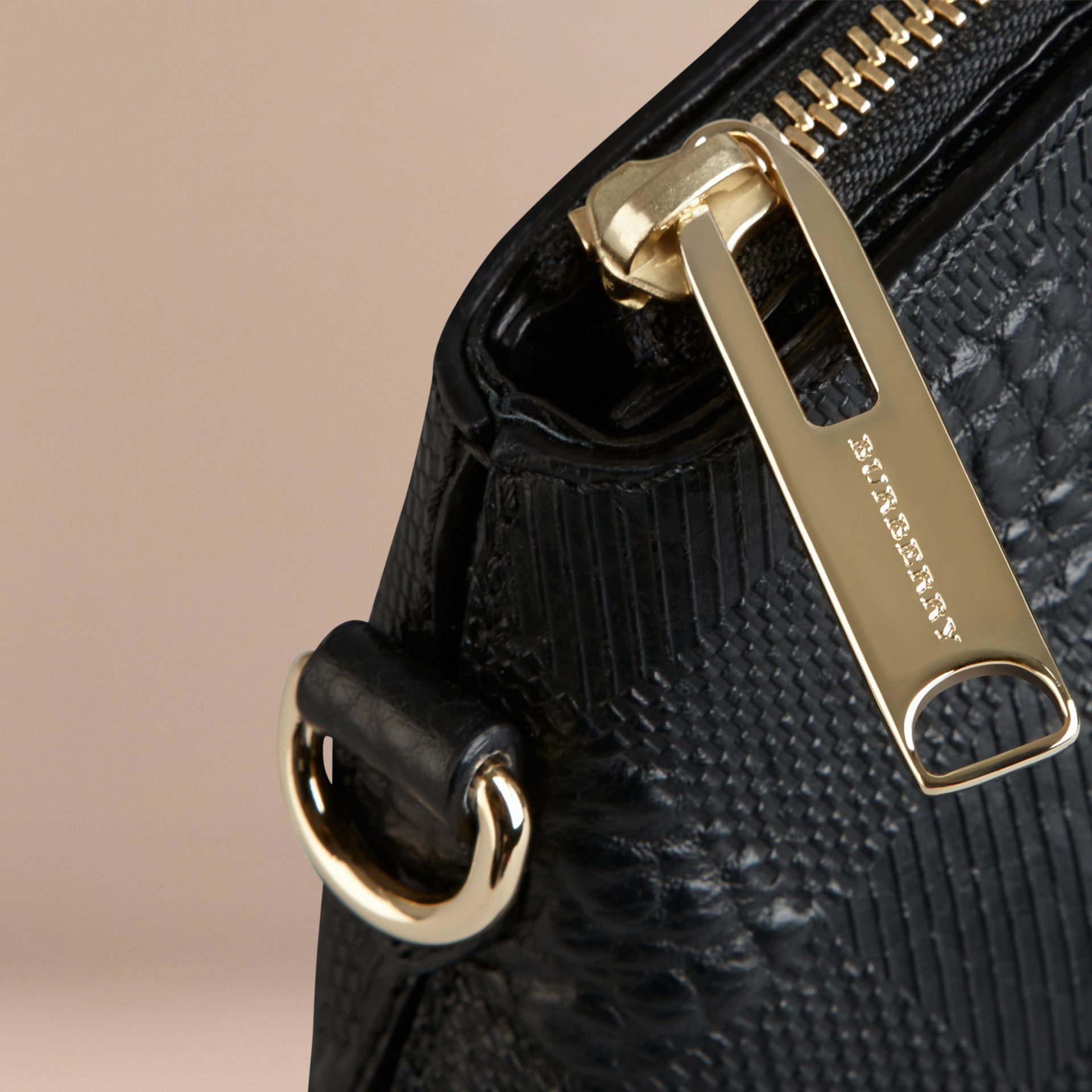 Small Embossed Check Leather Clutch Bag in Black - gallery image 6