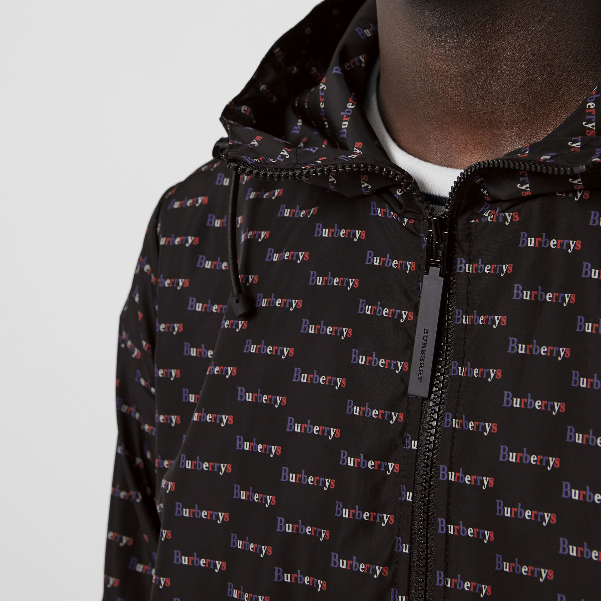Archive Logo Print Lightweight Hooded Jacket in Black - Men | Burberry United Kingdom - gallery image 1