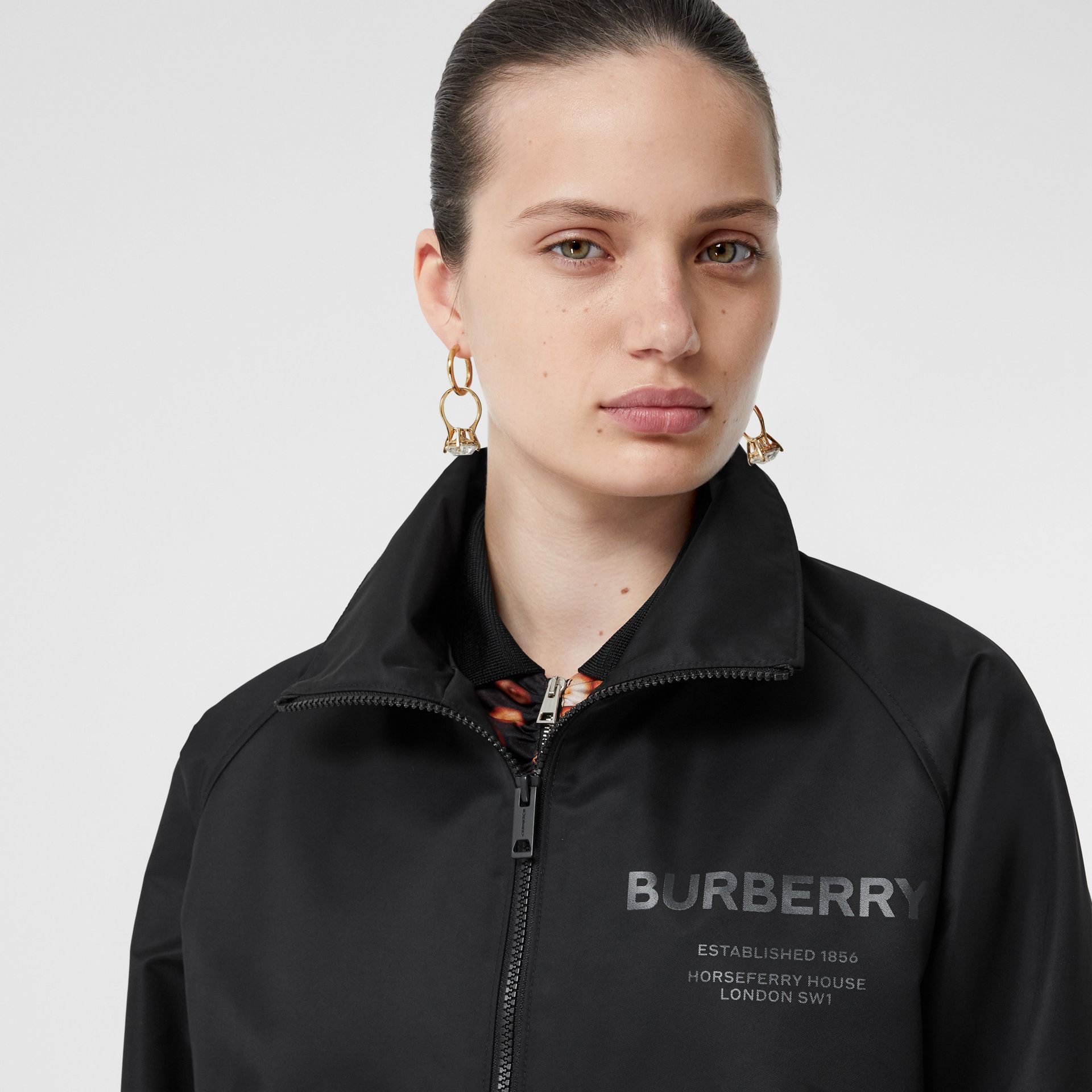 Horseferry Print Lightweight Funnel Neck Jacket in Black - Women | Burberry - gallery image 1