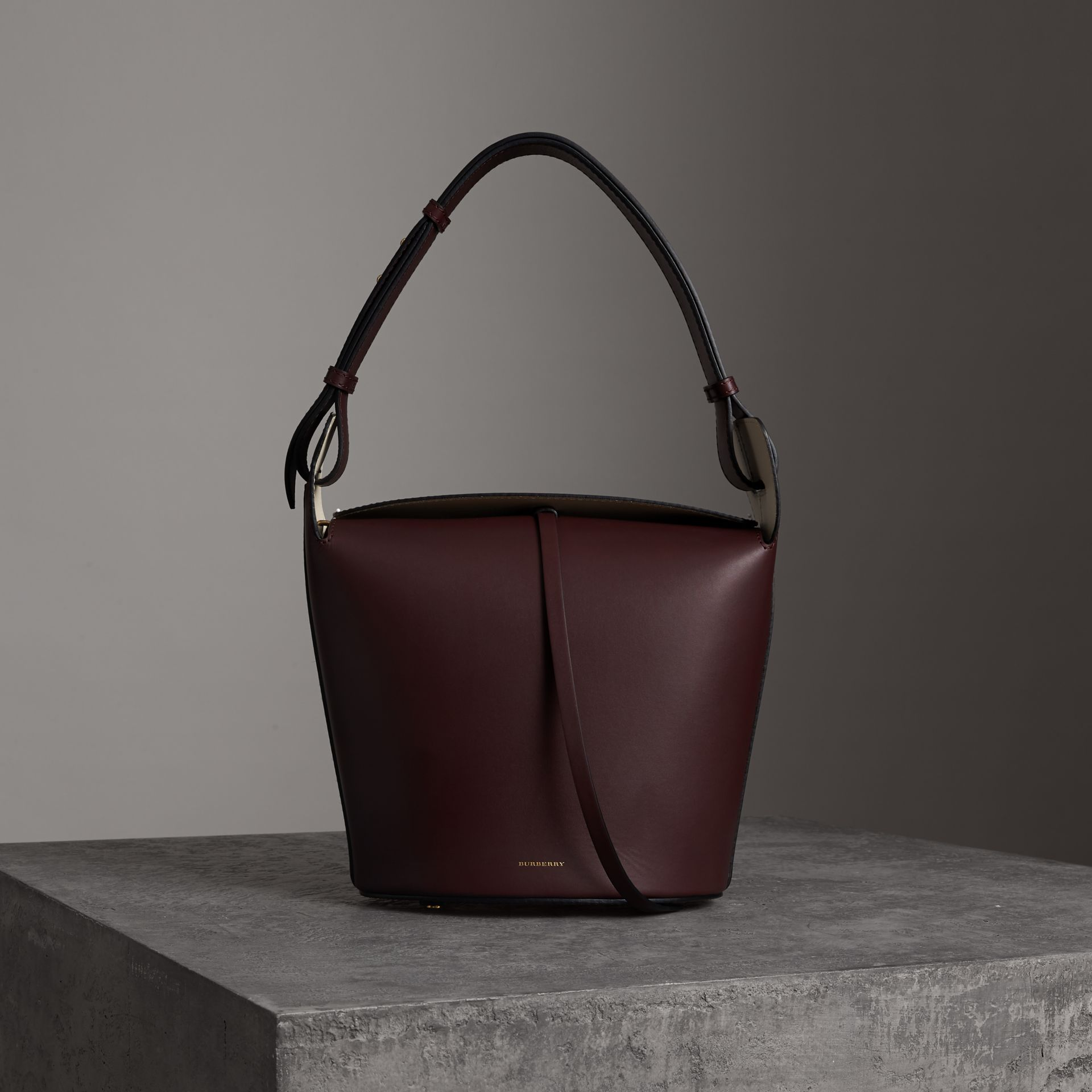 Burberry The Medium Leather Bucket Bag In Red. First seen in May 2018.  Product  Strap  10.8 in. Depth  7.5 in. Width  11.2 in. Height  13 in 550a9e26a2