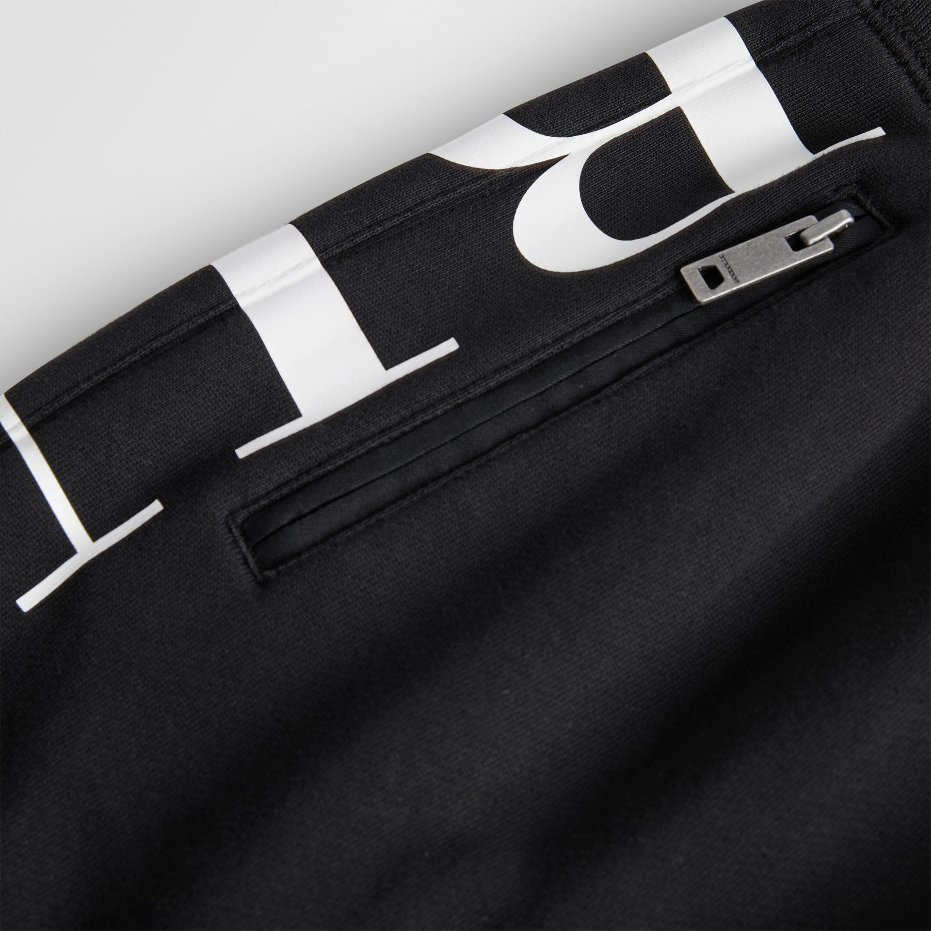 Logo Print Cotton Trackpants in Black | Burberry - gallery image 1