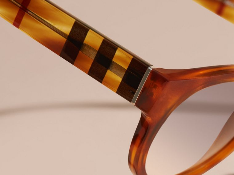 Check and Camouflage Detail Round Frame Sunglasses in Light Russet Brown - Women | Burberry - cell image 1