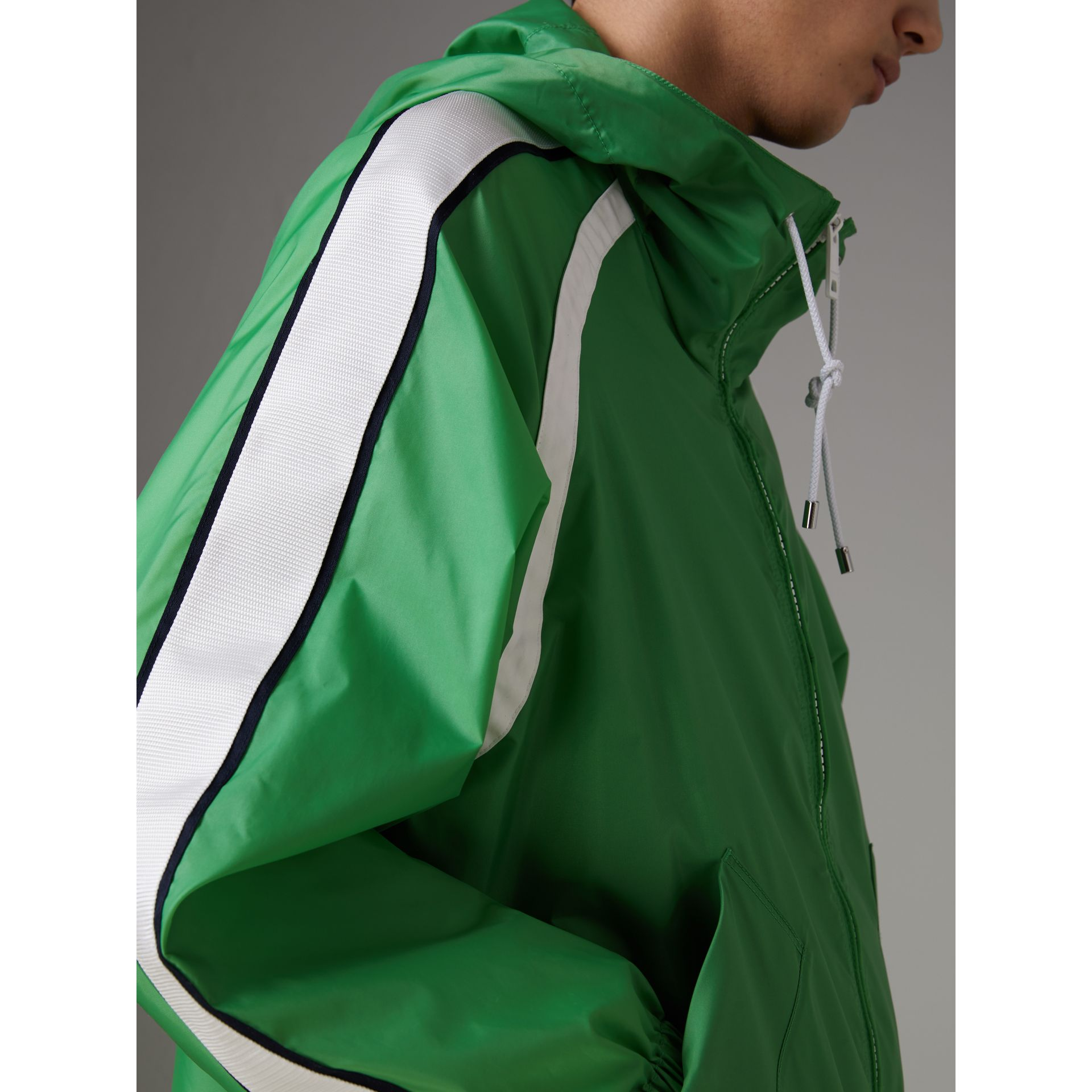 Stripe Detail Showerproof Hooded Jacket in Bright Pigment Green - Men | Burberry United Kingdom - gallery image 1