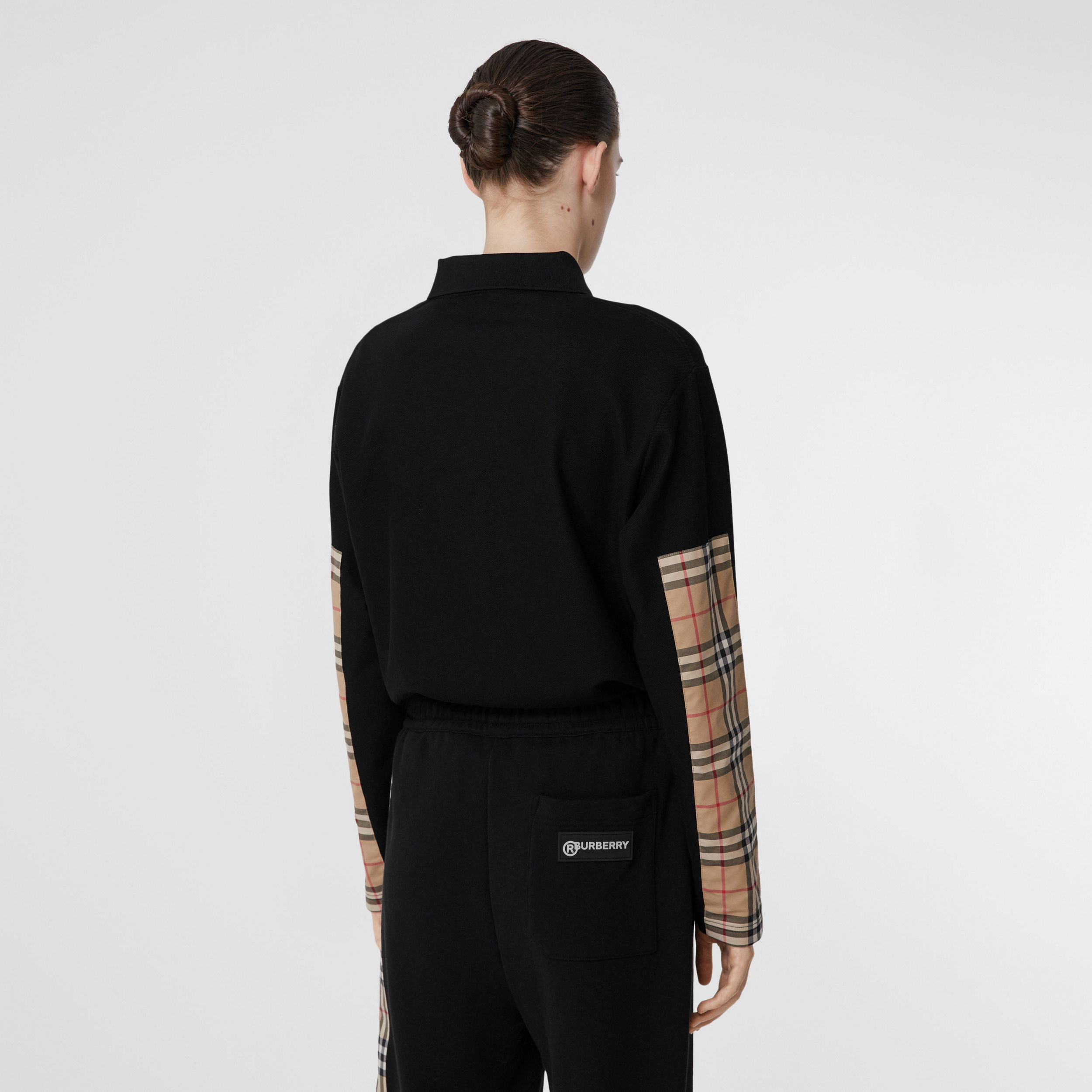 Long-sleeve Vintage Check Panel Oversized Polo Shirt in Black - Women | Burberry - 3