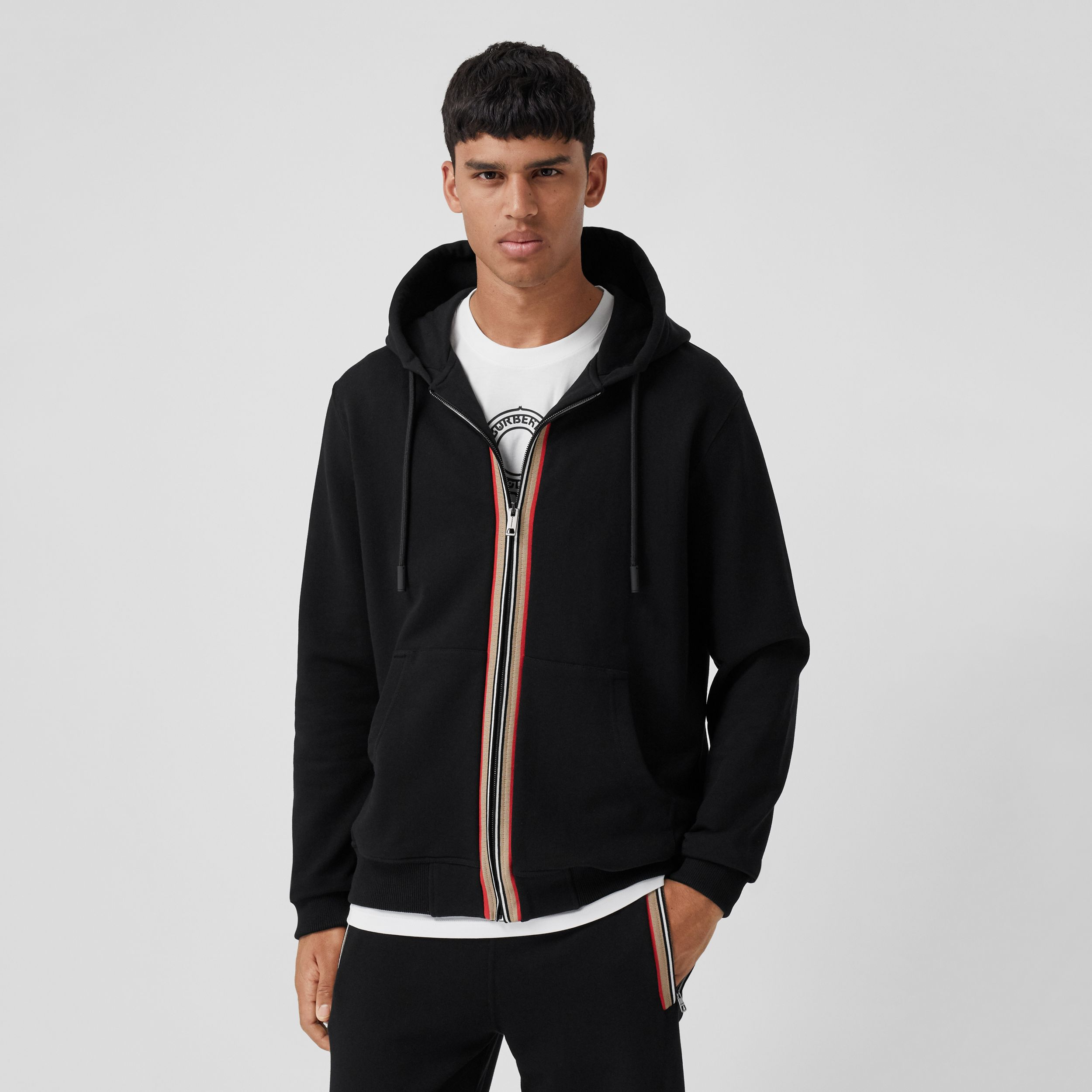 Icon Stripe Detail Cotton Hooded Top in Black - Men | Burberry - 1