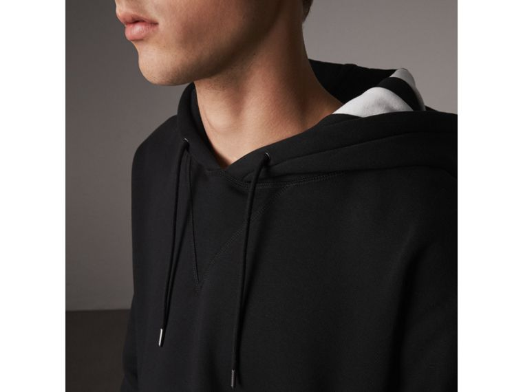 Bold Stripe Detail Oversize Hooded Sweatshirt in Black - Men | Burberry Hong Kong - cell image 1