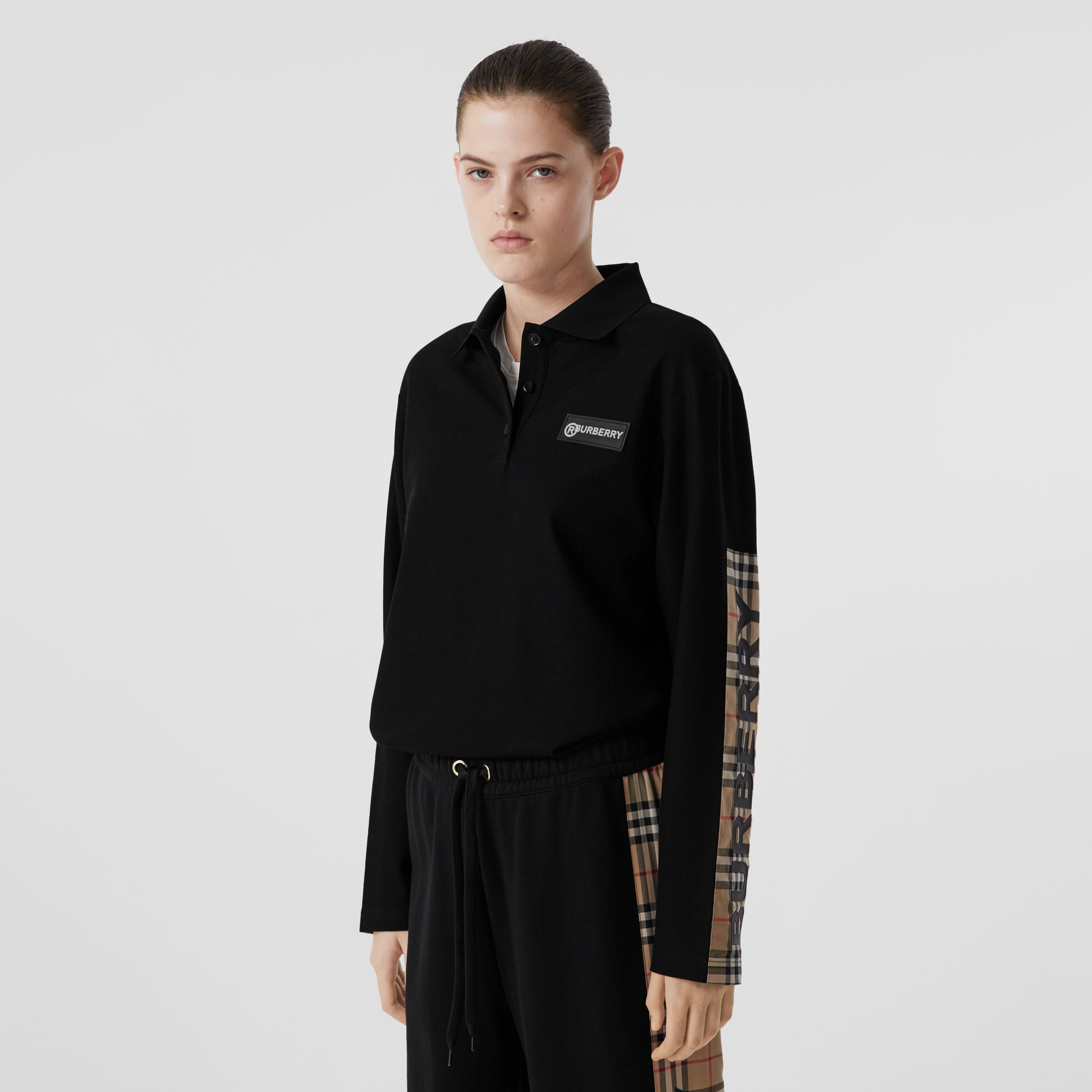 Long-sleeve Vintage Check Panel Oversized Polo Shirt in Black - Women | Burberry - 1