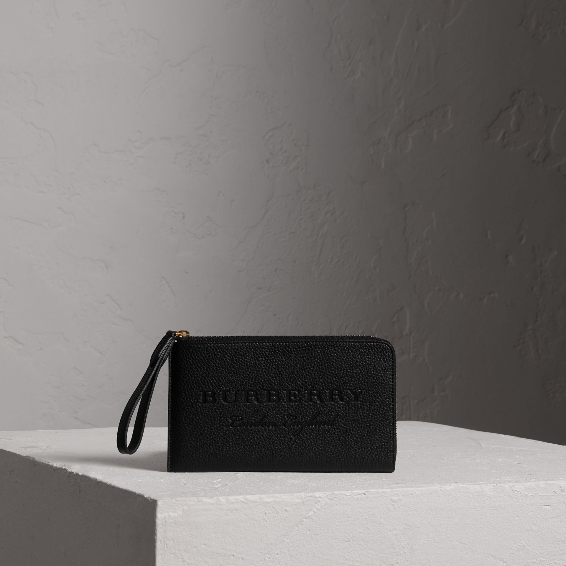 Embossed Leather Travel Wallet in Black | Burberry Australia - gallery image 0
