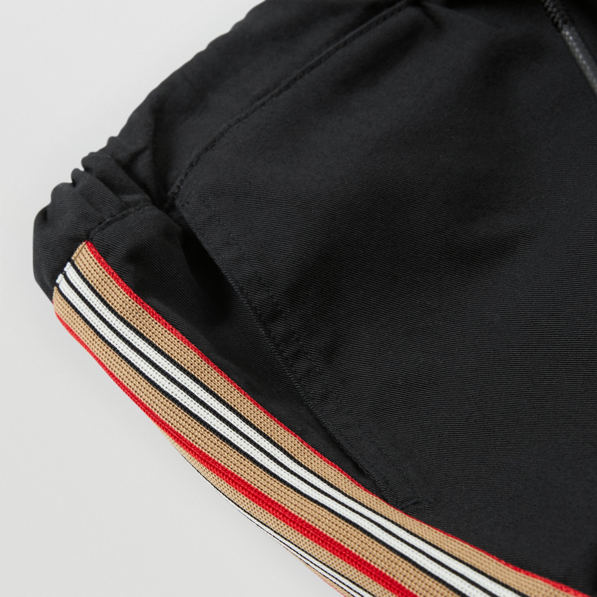 Icon Stripe Detail Cotton Chinos in Black | Burberry - gallery image 1