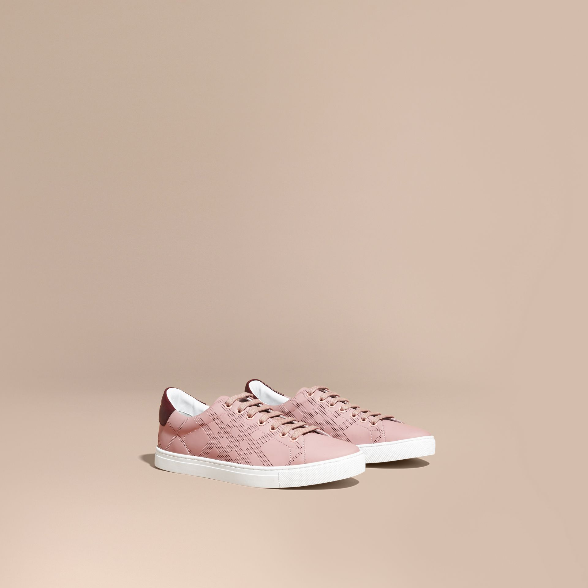 Perforated Check Leather Trainers in Rose Pink/deep Claret Melange - Men | Burberry - gallery image 1