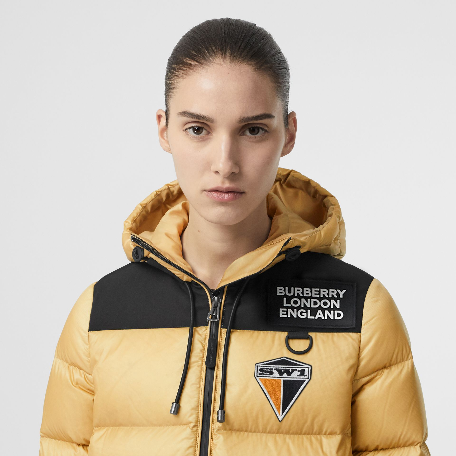Logo Graphic Hooded Puffer Jacket in Pale Stone - Women | Burberry - gallery image 1