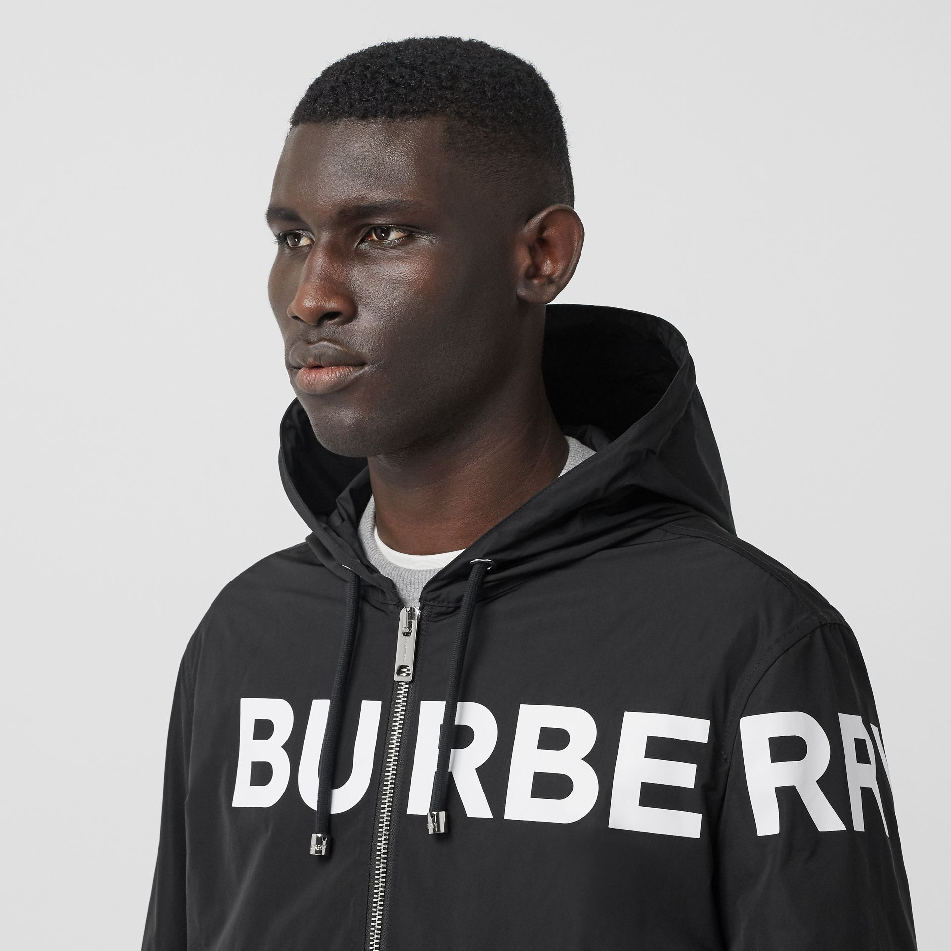 Horseferry Print Nylon Hooded Jacket in Black - Men | Burberry - gallery image 1