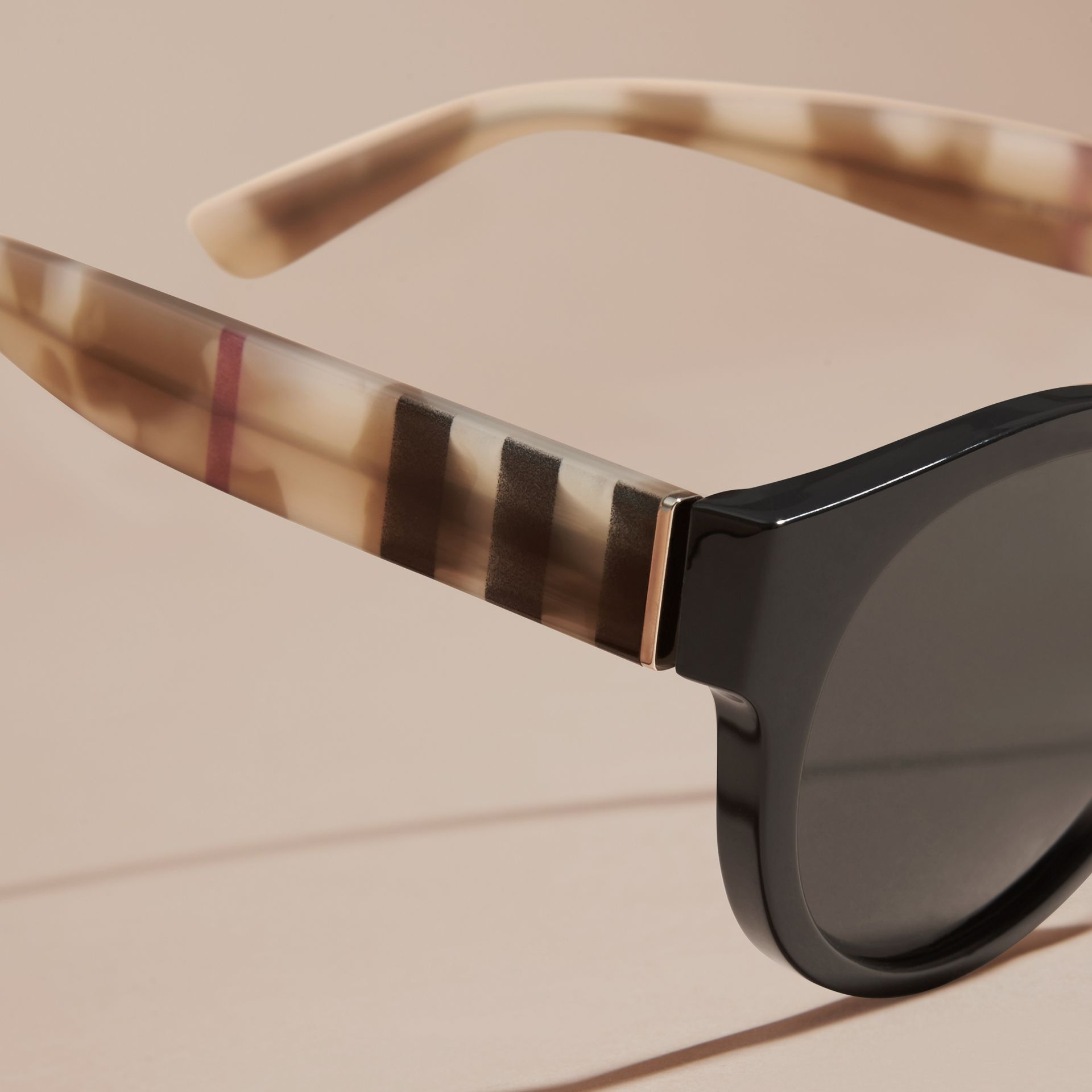 Check and Camouflage Detail Round Frame Sunglasses in Black - Women | Burberry Singapore - gallery image 2