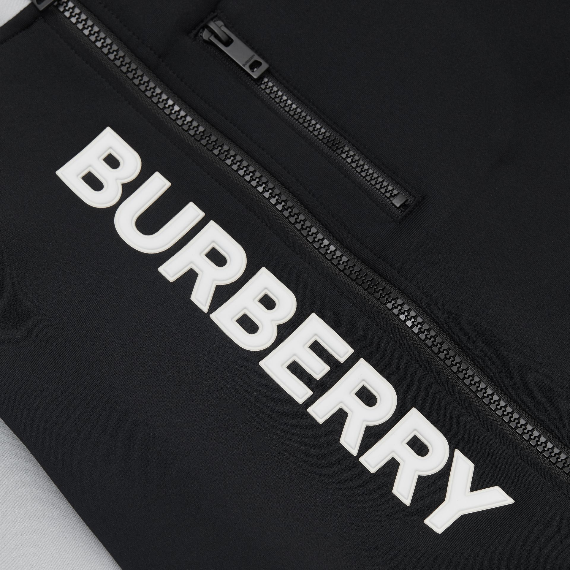 Logo Print Two-tone Stretch Jersey Track Top in Black | Burberry - gallery image 1