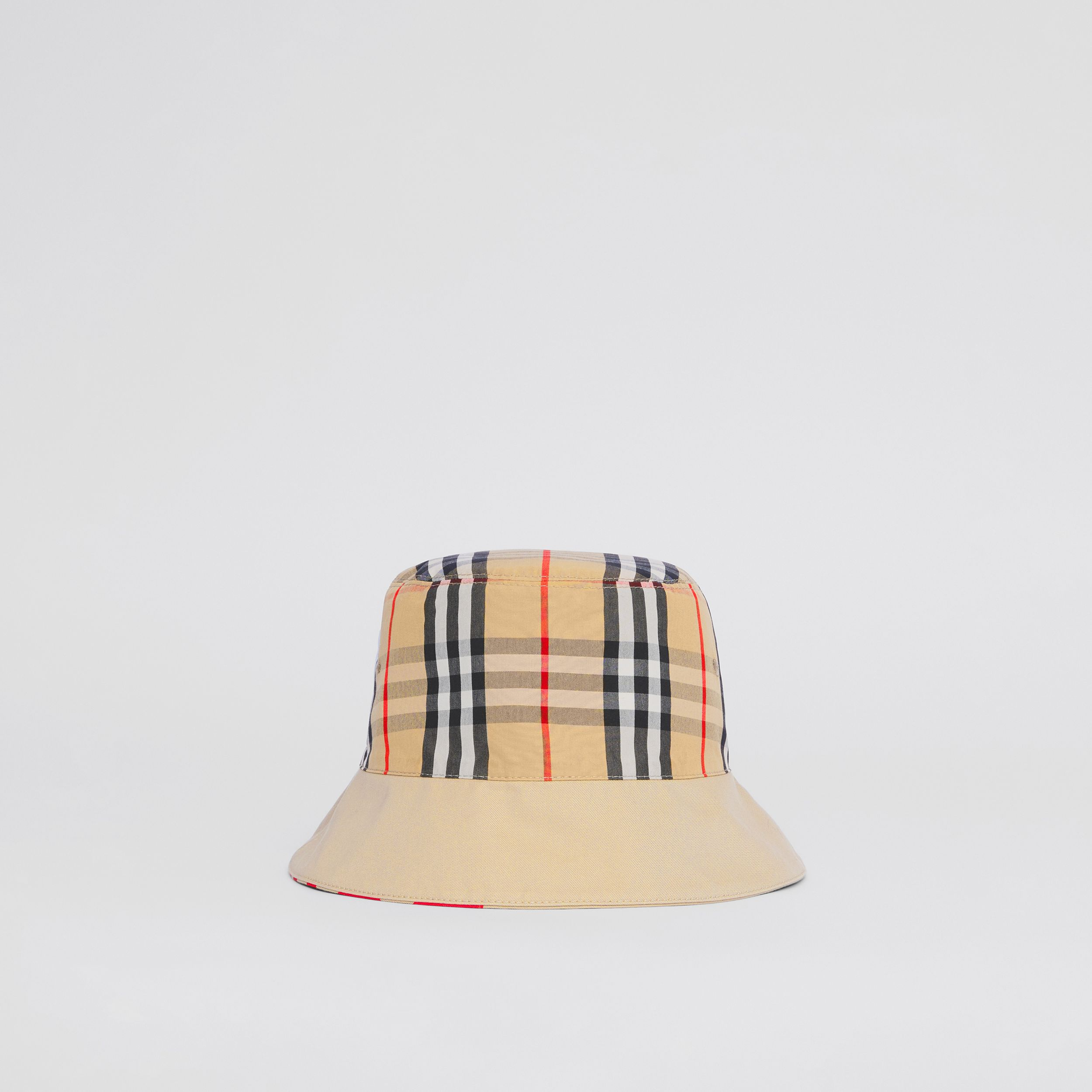 Reversible Logo Print Cotton Gabardine Bucket Hat in Honey | Burberry United States - 1