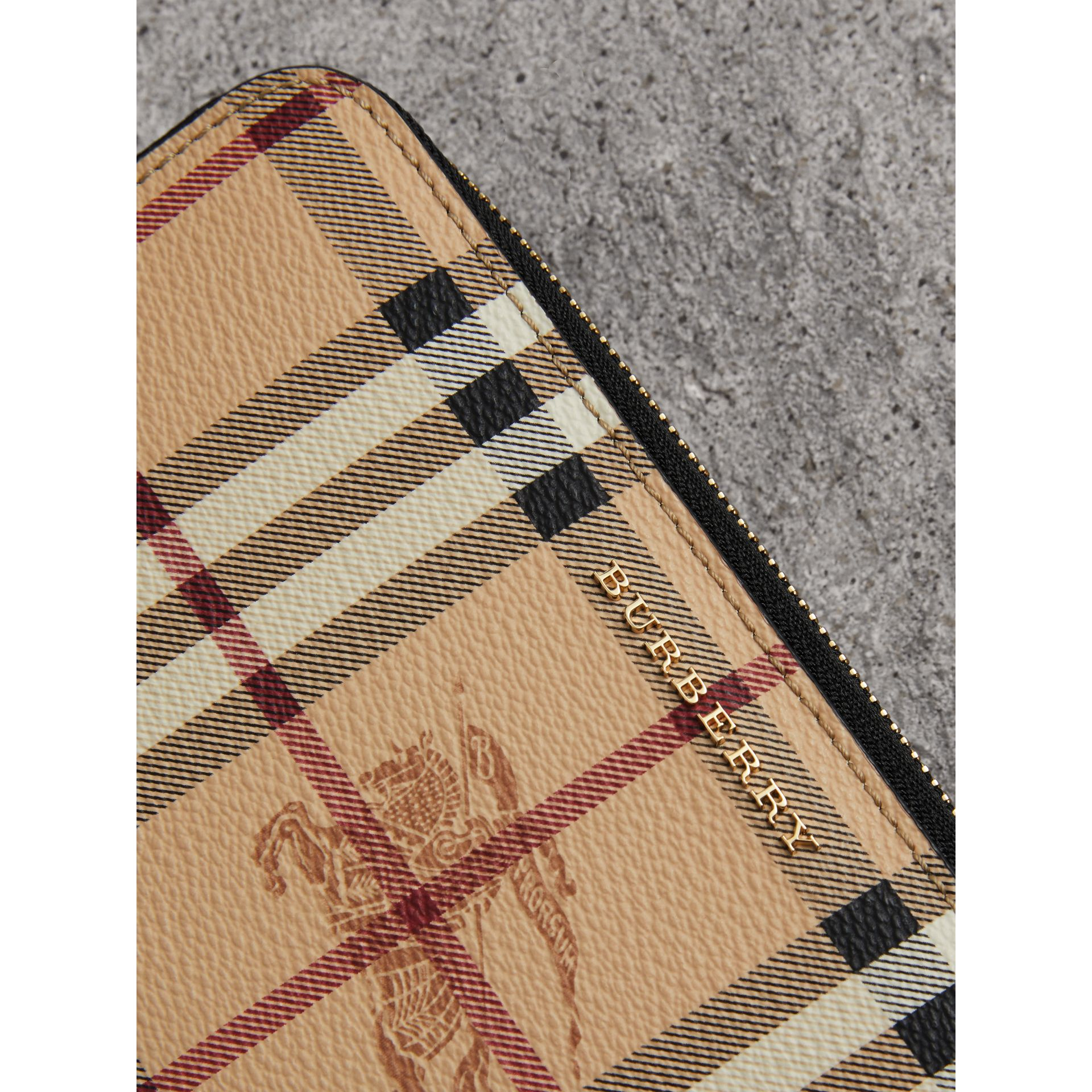 Haymarket Check and Leather Ziparound Wallet in Black - Women | Burberry United Kingdom - gallery image 1