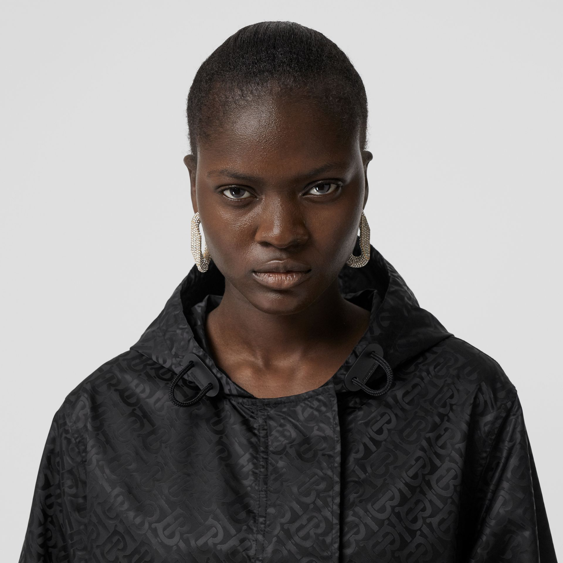 Monogram ECONYL® Jacquard Hooded Parka in Black - Women | Burberry United Kingdom - gallery image 1