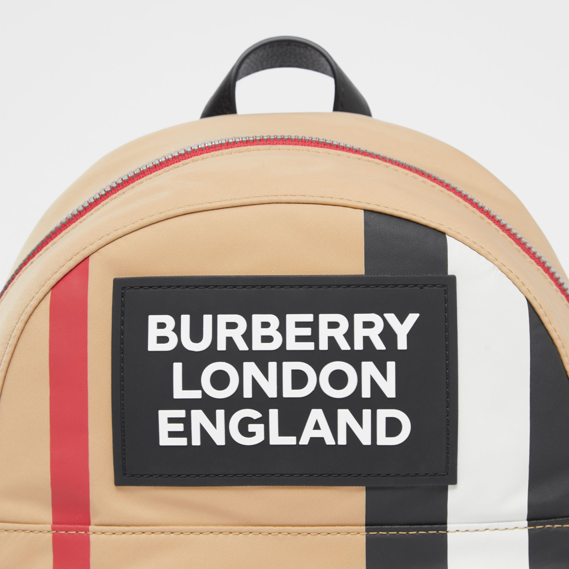 Logo Appliqué Icon Stripe ECONYL® Backpack in Archive Beige - Children | Burberry United Kingdom - gallery image 1