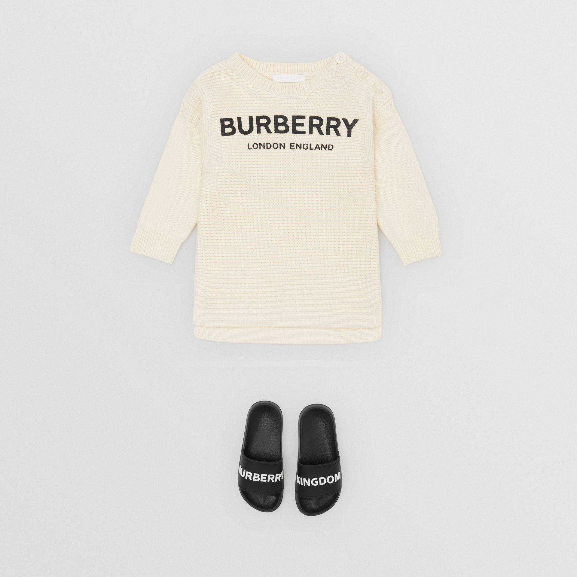Logo Print Rib Knit Merino Wool Sweater Dress in Ivory - Children | Burberry - gallery image 2