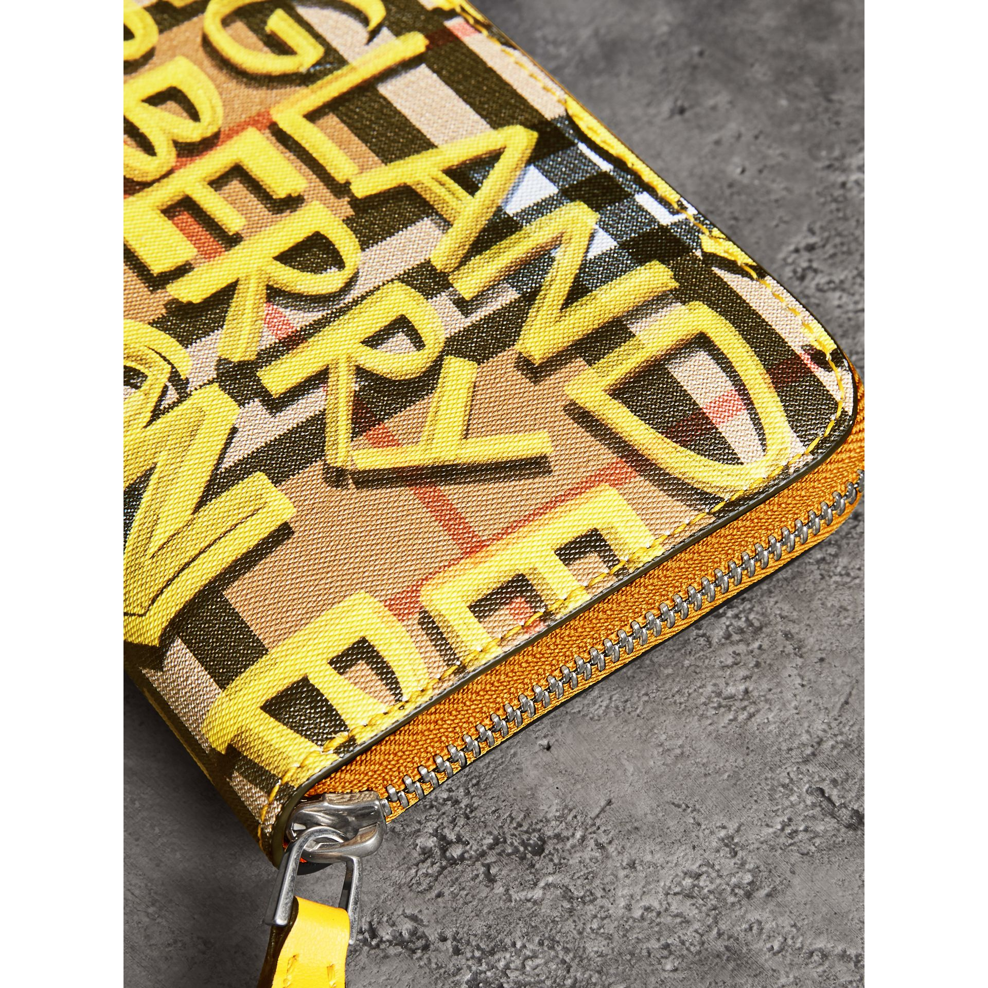 Graffiti Print Vintage Check Leather Ziparound Wallet in Yellow - Women | Burberry Canada - gallery image 1