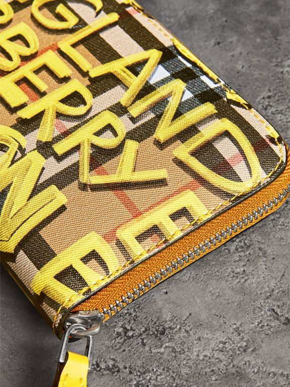 Graffiti Print Vintage Check Leather Ziparound Wallet in Yellow - Women | Burberry Canada - cell image 1