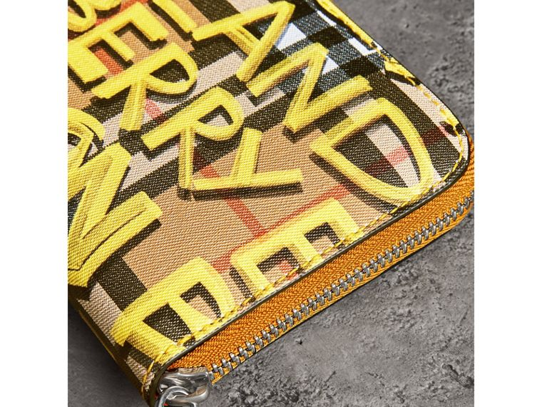 Graffiti Print Vintage Check Leather Ziparound Wallet in Yellow - Women | Burberry - cell image 1