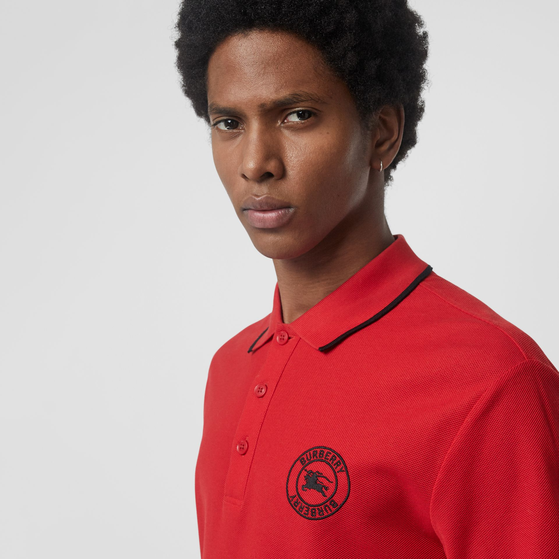 Embroidered Logo Cotton Piqué Polo Shirt in Military Red - Men | Burberry - gallery image 1