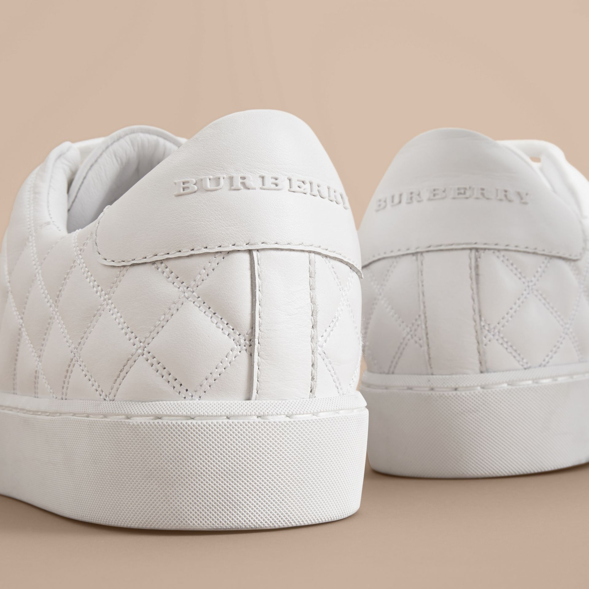 Check-quilted Leather Sneakers in Optic White - Women | Burberry Australia - gallery image 1