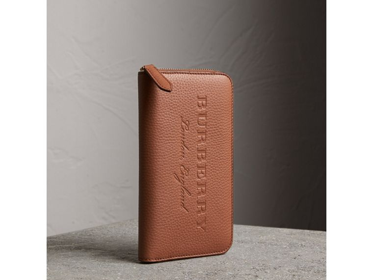 Embossed Grainy Leather Ziparound Wallet in Chestnut Brown - Men | Burberry United Kingdom - cell image 1