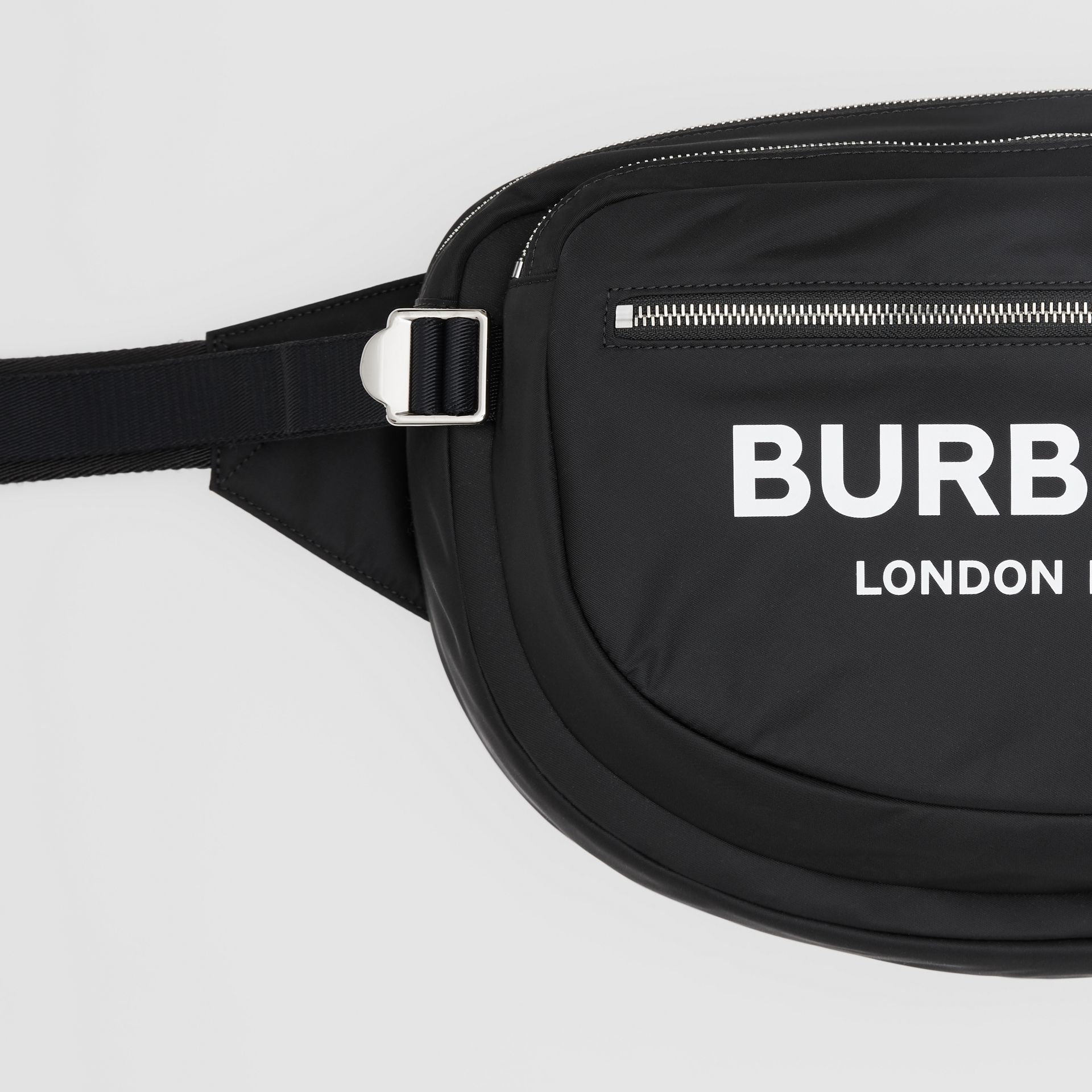 Large Logo Print ECONYL® Cannon Bag in Black | Burberry - gallery image 1