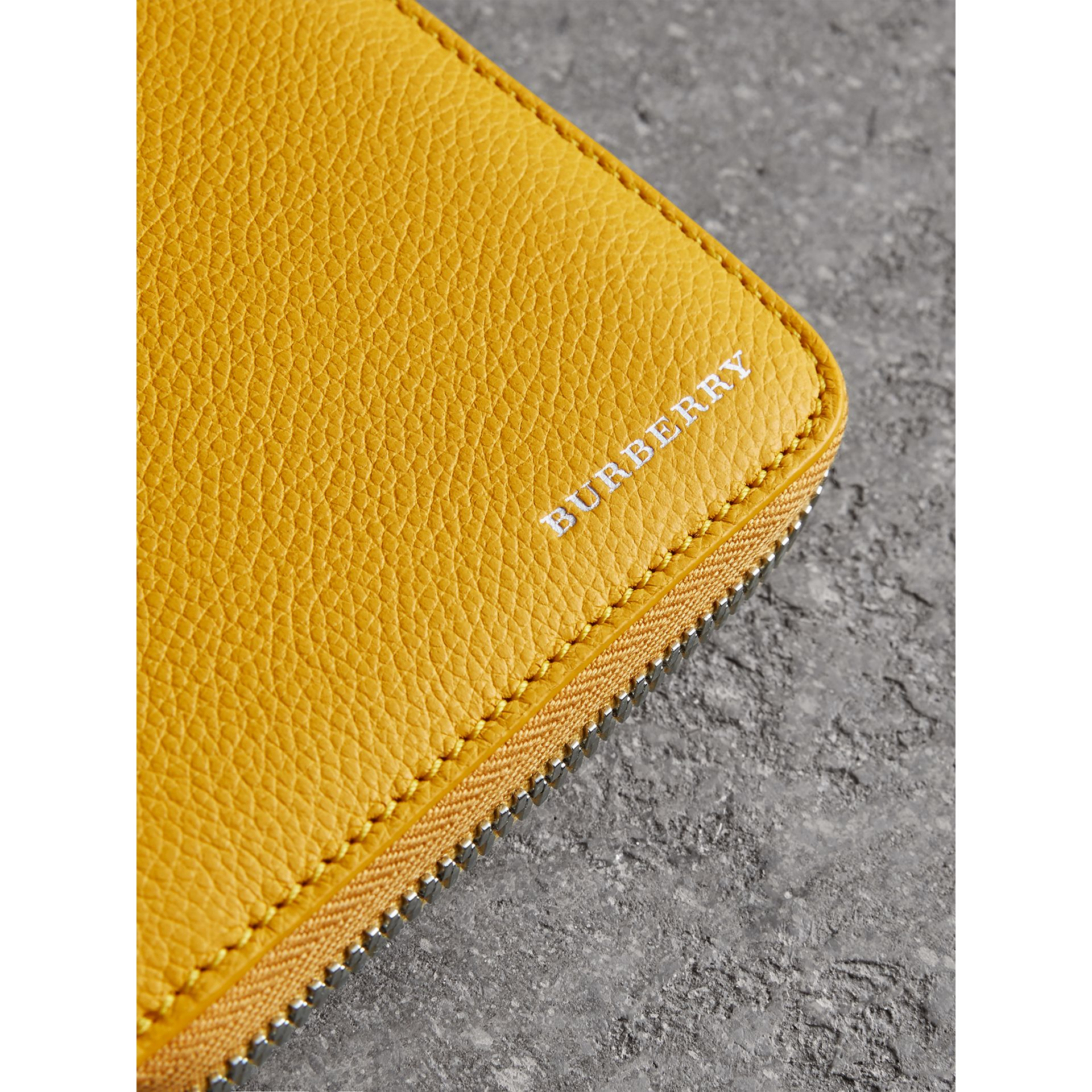 Grainy Leather Ziparound Wallet in Bright Ochre Yellow - Men | Burberry - gallery image 1
