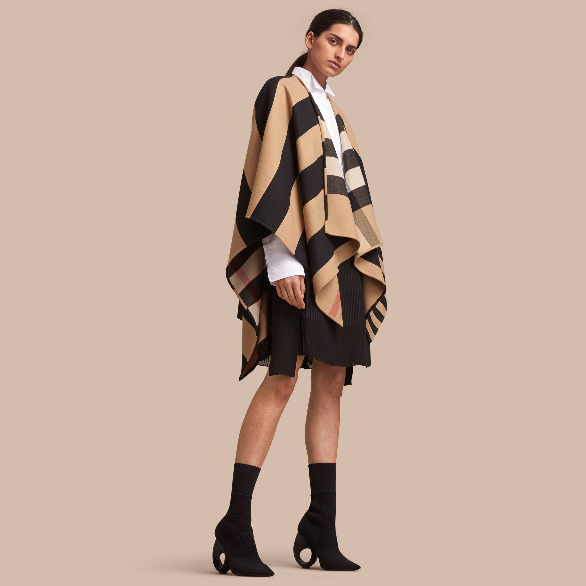 Reversible Stripe and Check Merino Wool Poncho in Camel - Women | Burberry - gallery image 1